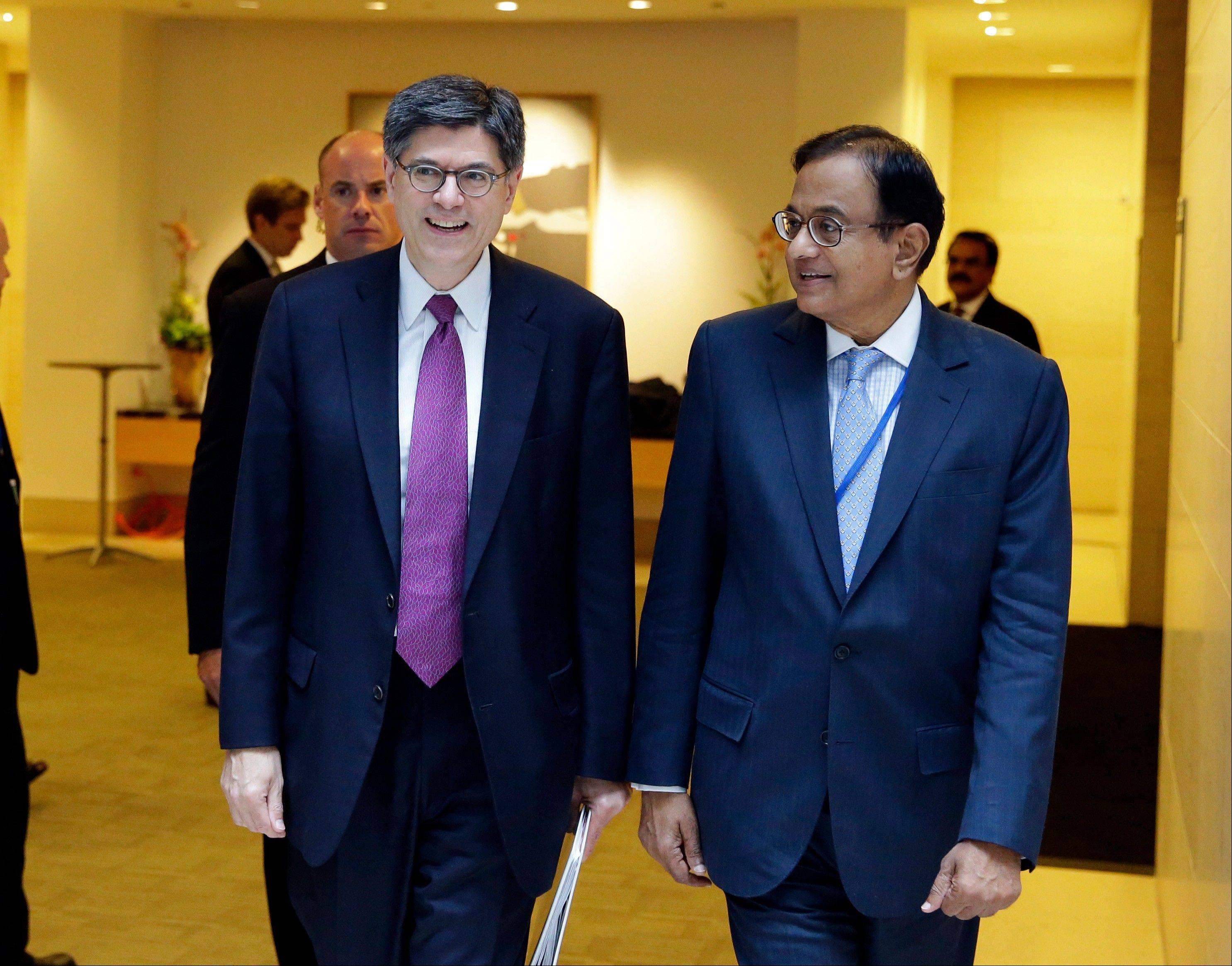 Jacob Lew, left, U.S. Secretary of the Treasury, and Shri P. Chidambaram, the Finance Minister for India, leave after their bi-lateral meeting Sunday at the International Monetary Fund in Washington. Finance ministers and central bank officials from the Group of 20 nations are in Washington for weekend meetings of the 188-nation International Monetary Fund and its sister lending organization, the World Bank.