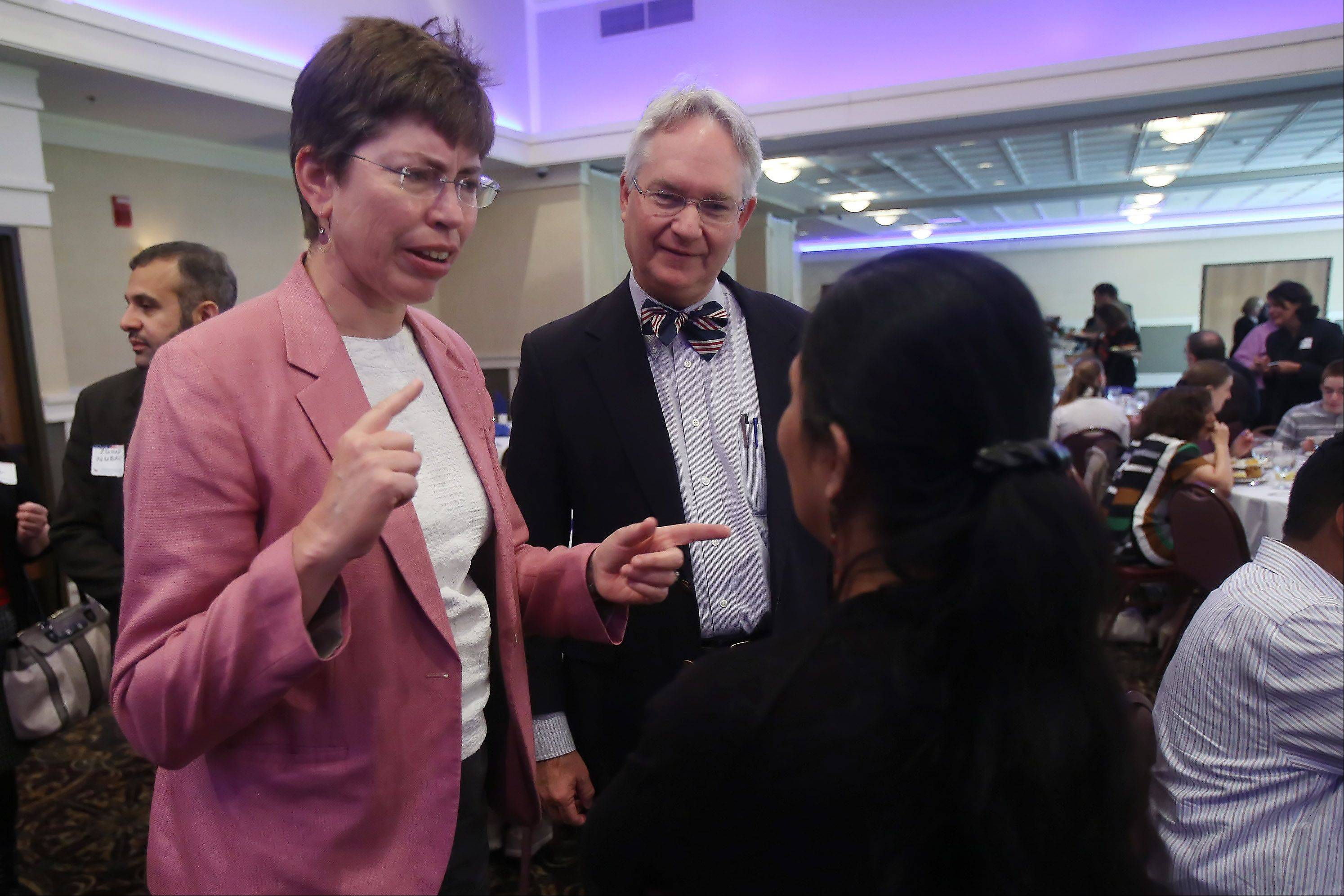Lt. Gov. Sheila Simon, with her husband, Perry Knop, talks to a supporter during the Schaumburg Area Democrats' Meet the Candidates Breakfast Sunday.
