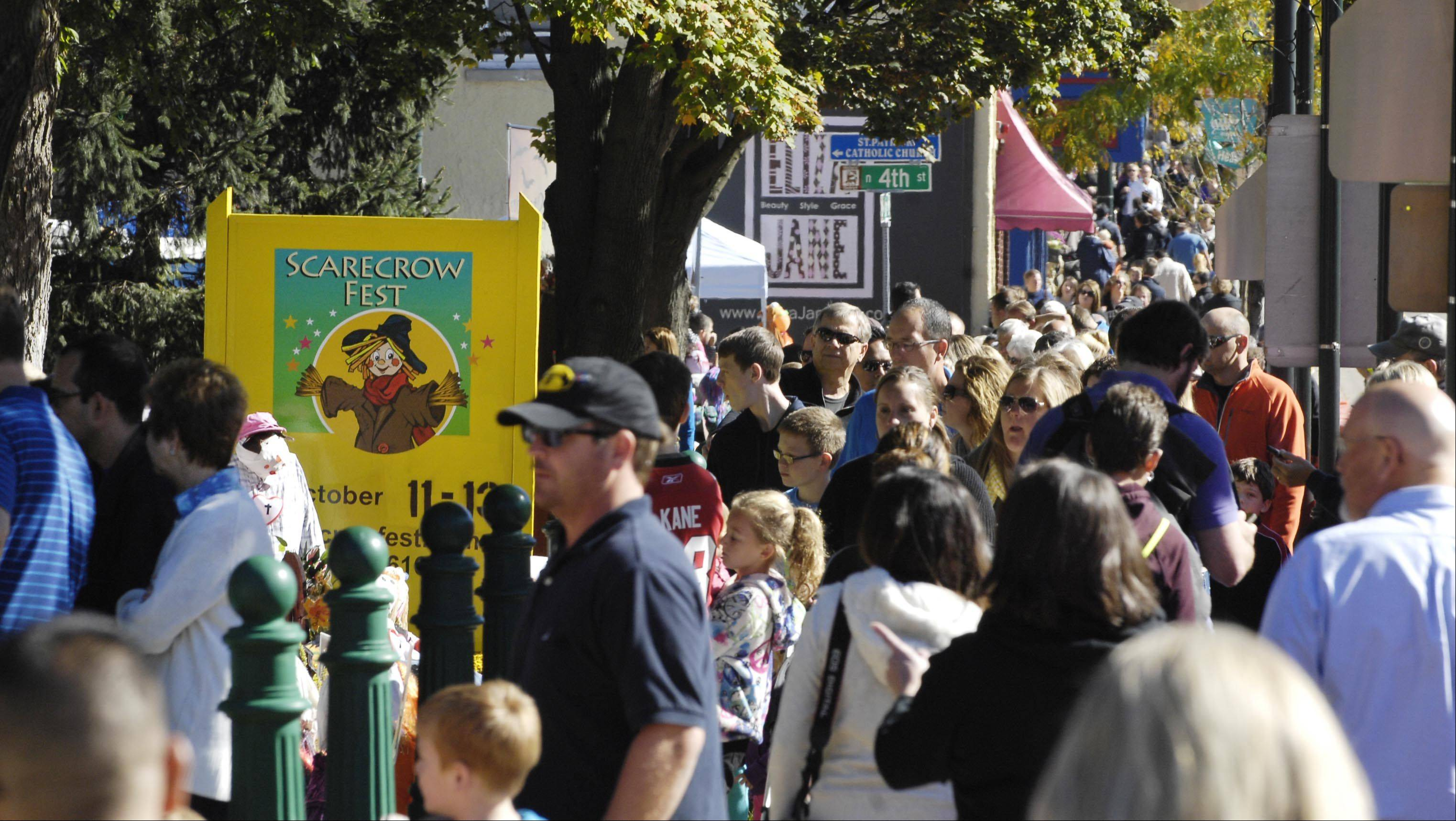 Sidewalks were crowded all morning Sunday at the 28th annual St. Charles Scarecrow Festival.