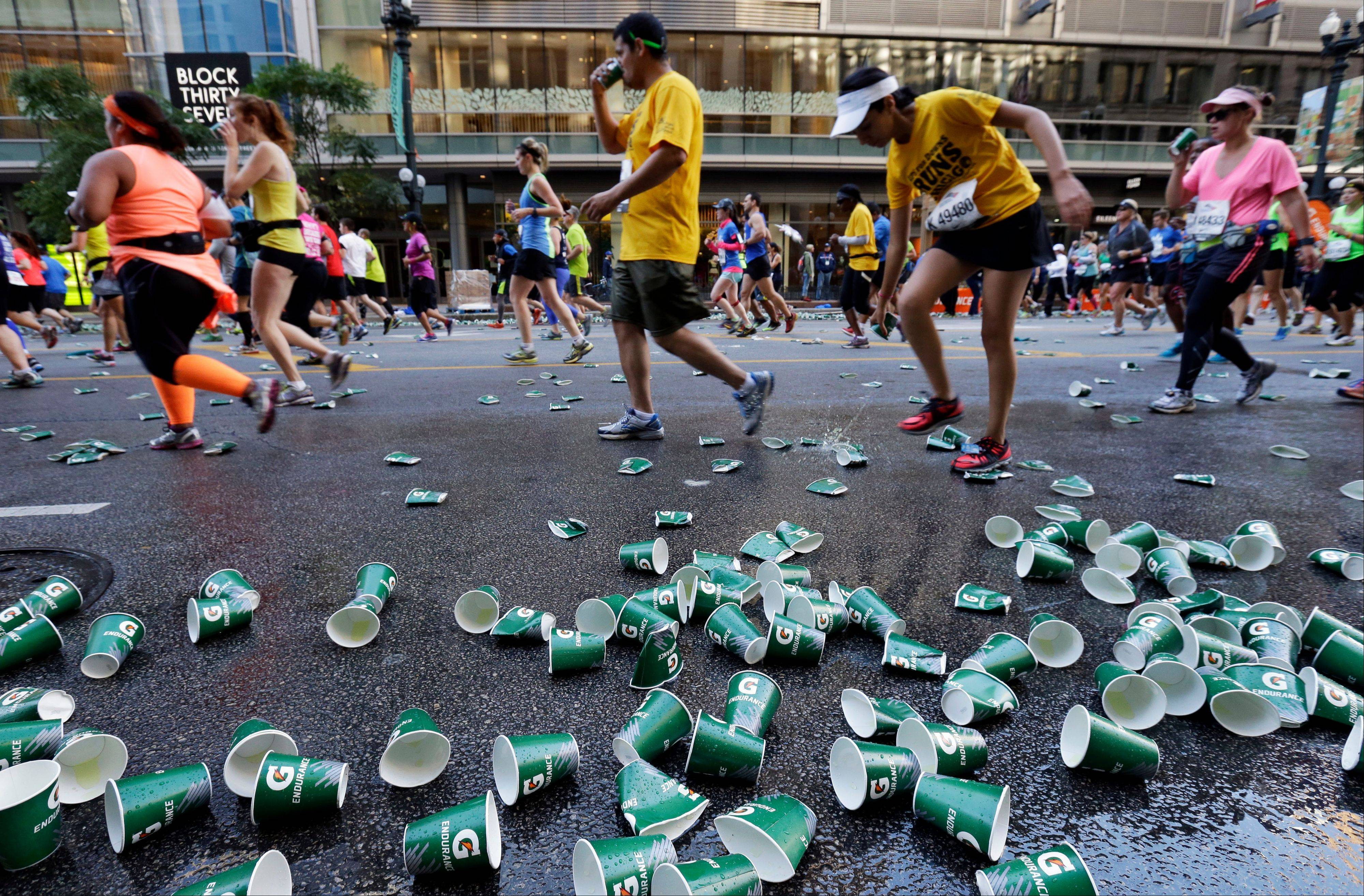 Runners participate in the Chicago Marathon in Chicago, Sunday, Oct. 13, 2013.