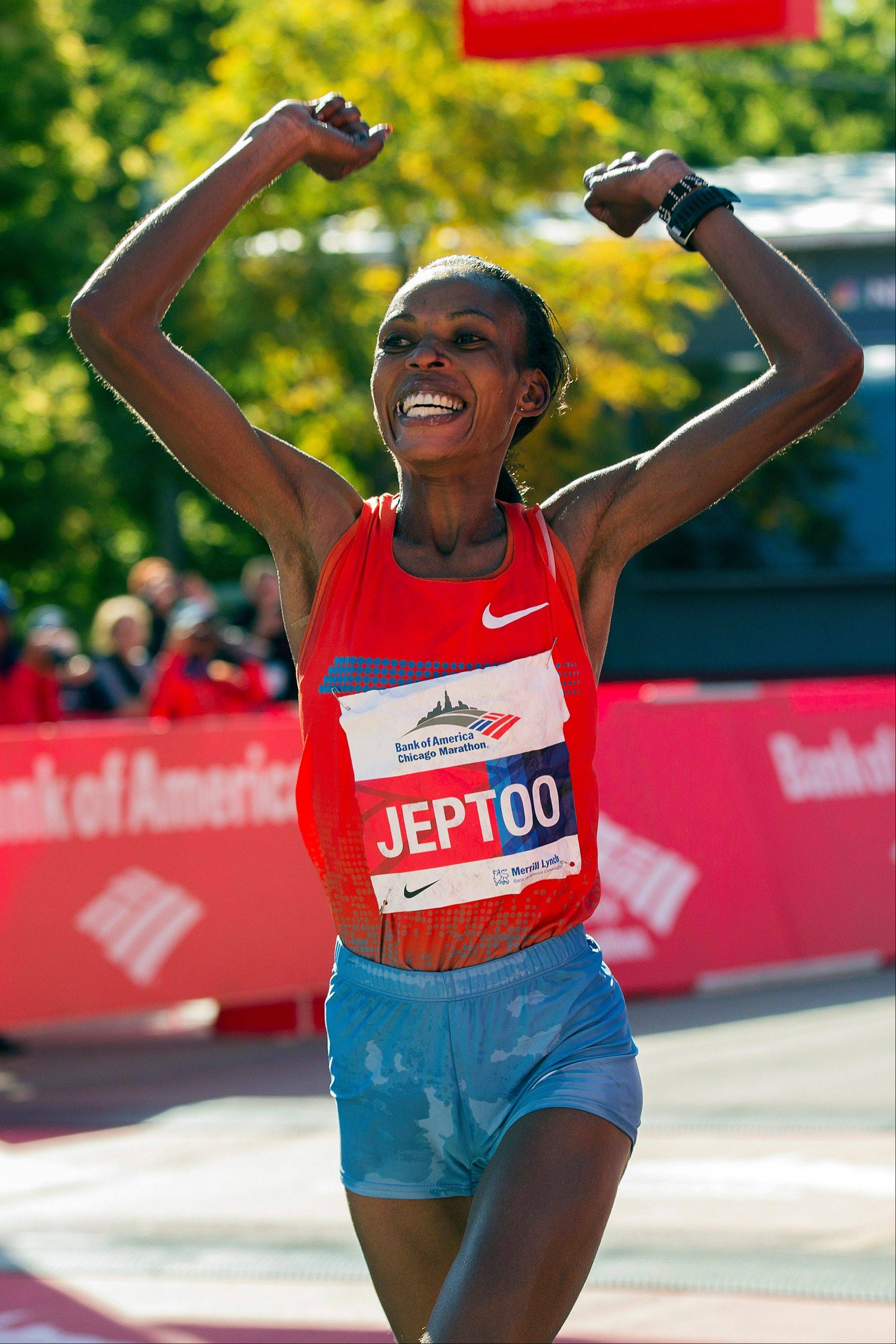 Rita Jeptoo of Kenya wins the women's race during the Chicago Marathon on Sunday, Oct. 13, 2013, in Chicago.
