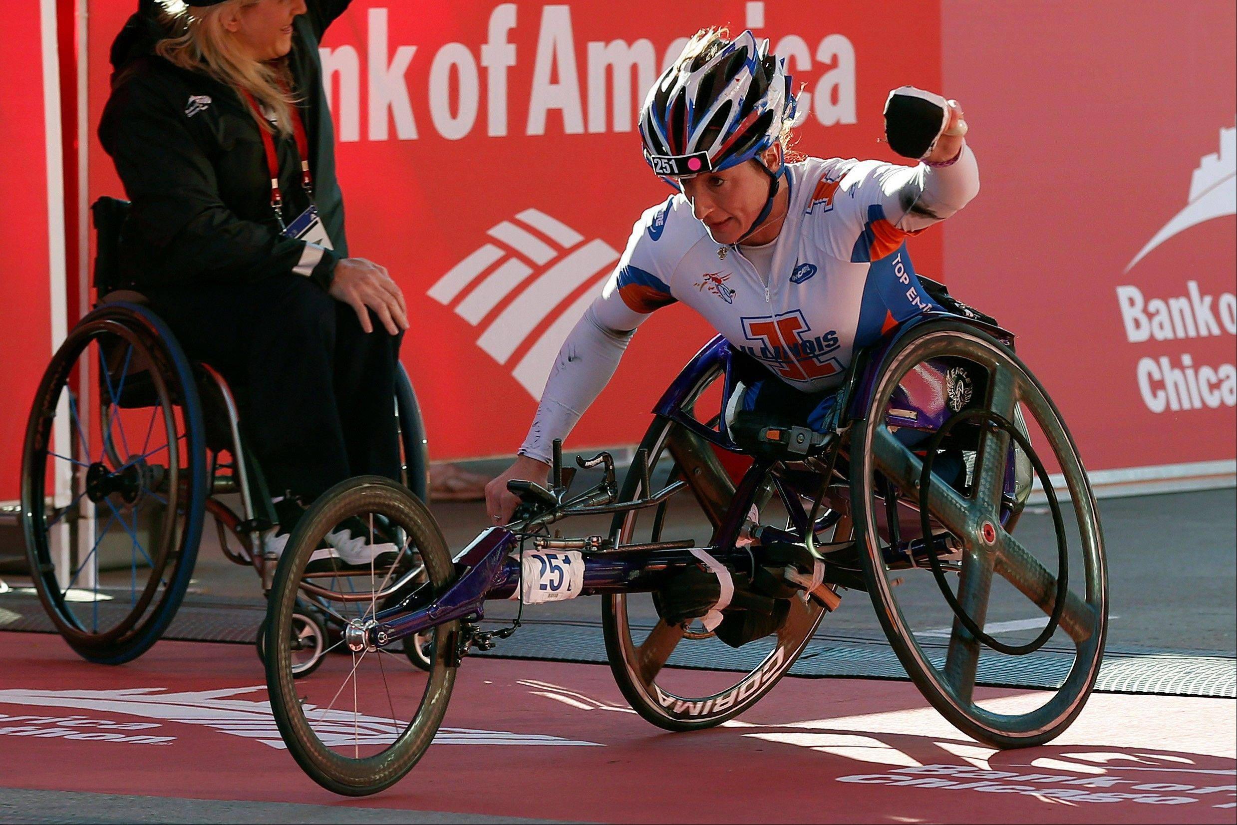 Tatyana McFadden, of Champaign, Ill., wins the woman's wheelchair division during the Chicago Marathon on Sunday, Oct. 13, 2013, in Chicago.