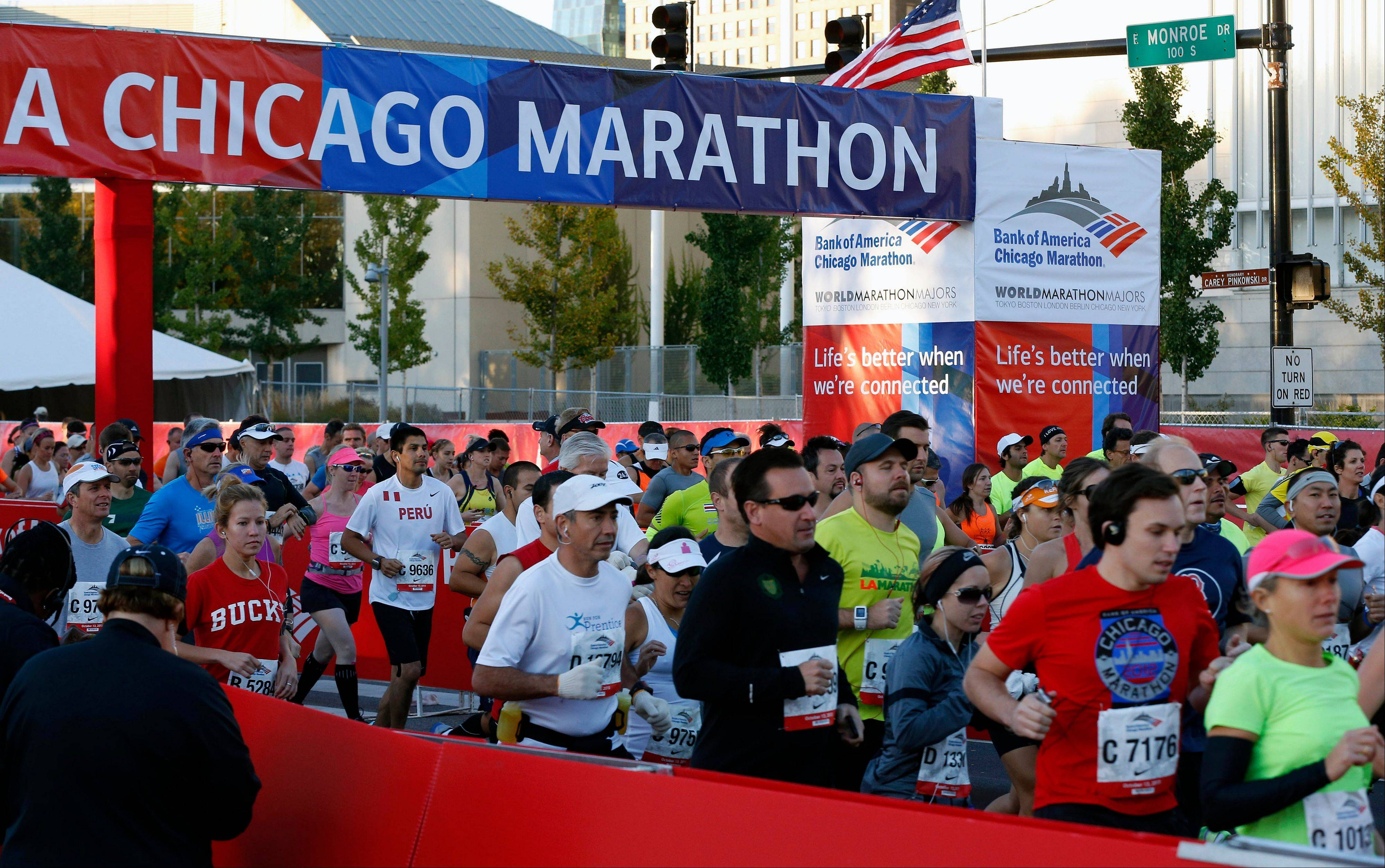 Runners depart from the starting line during the Chicago Marathon, Sunday, Oct. 13, 2013, in Chicago.