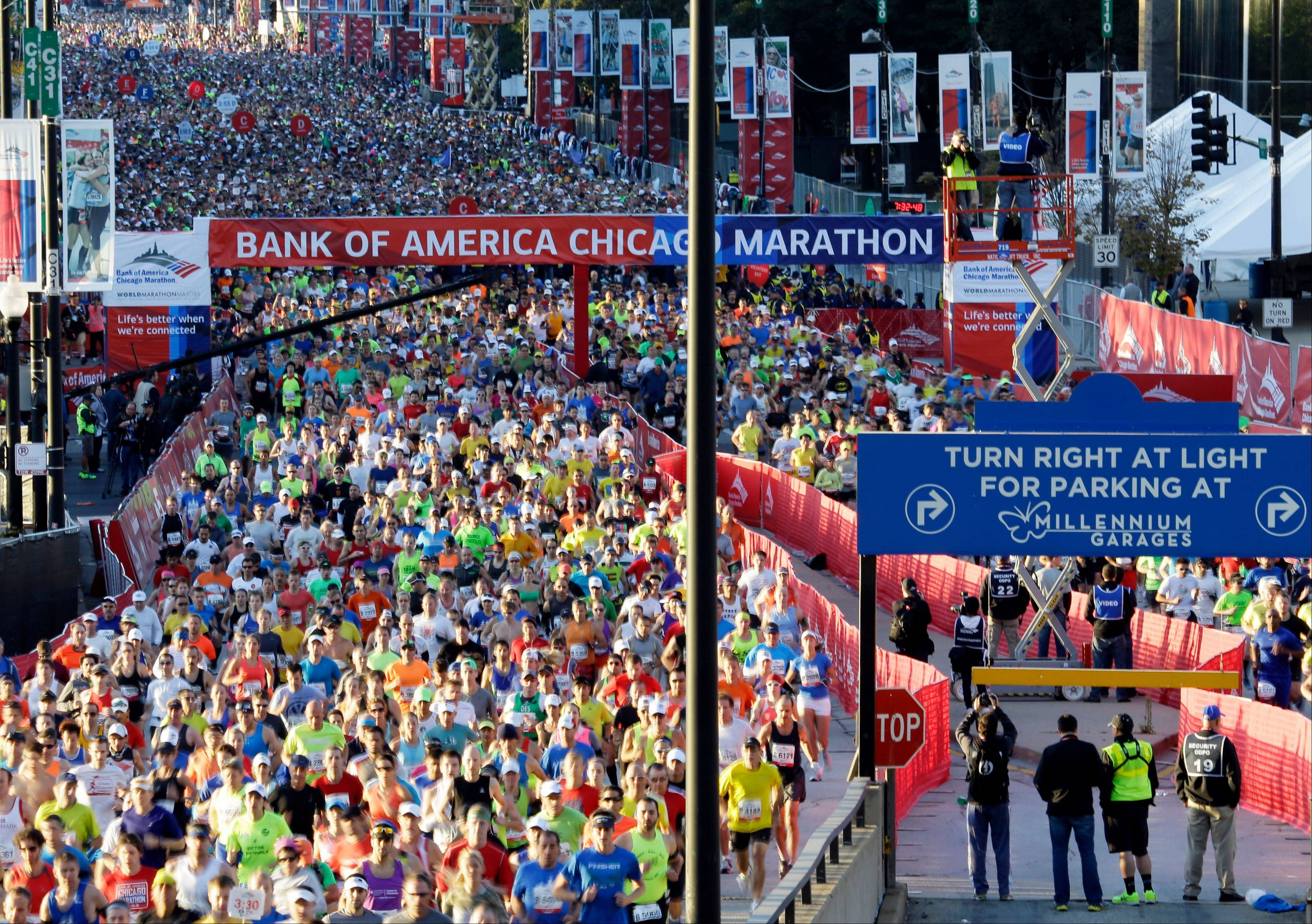 Runners start the Chicago Marathon in Chicago on Sunday.