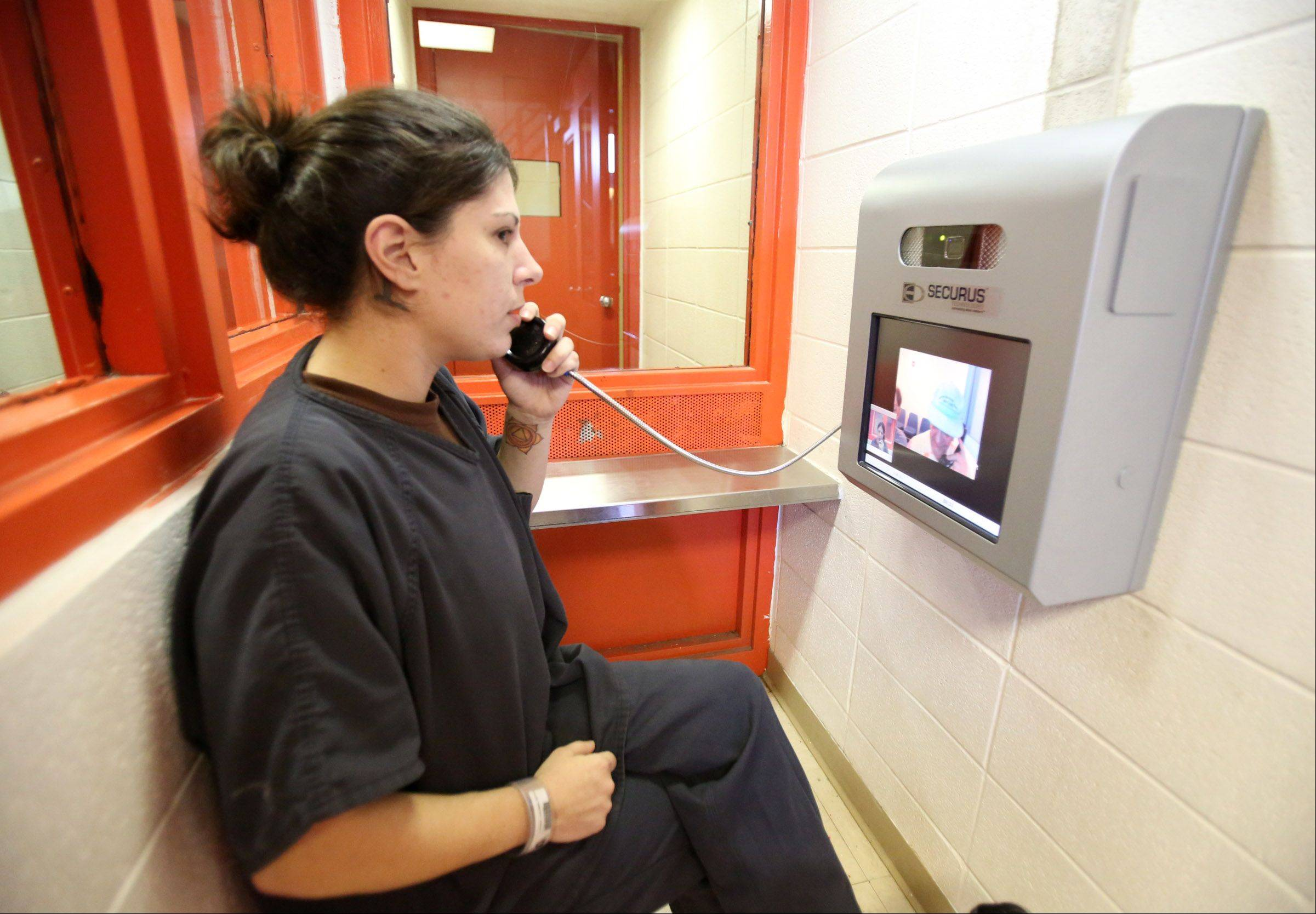 Beth Coleman, of Zion, an inmate at Lake County jail in Waukegan uses Skype to speak with her parents Ann and Mark Van Sickle of Zion.