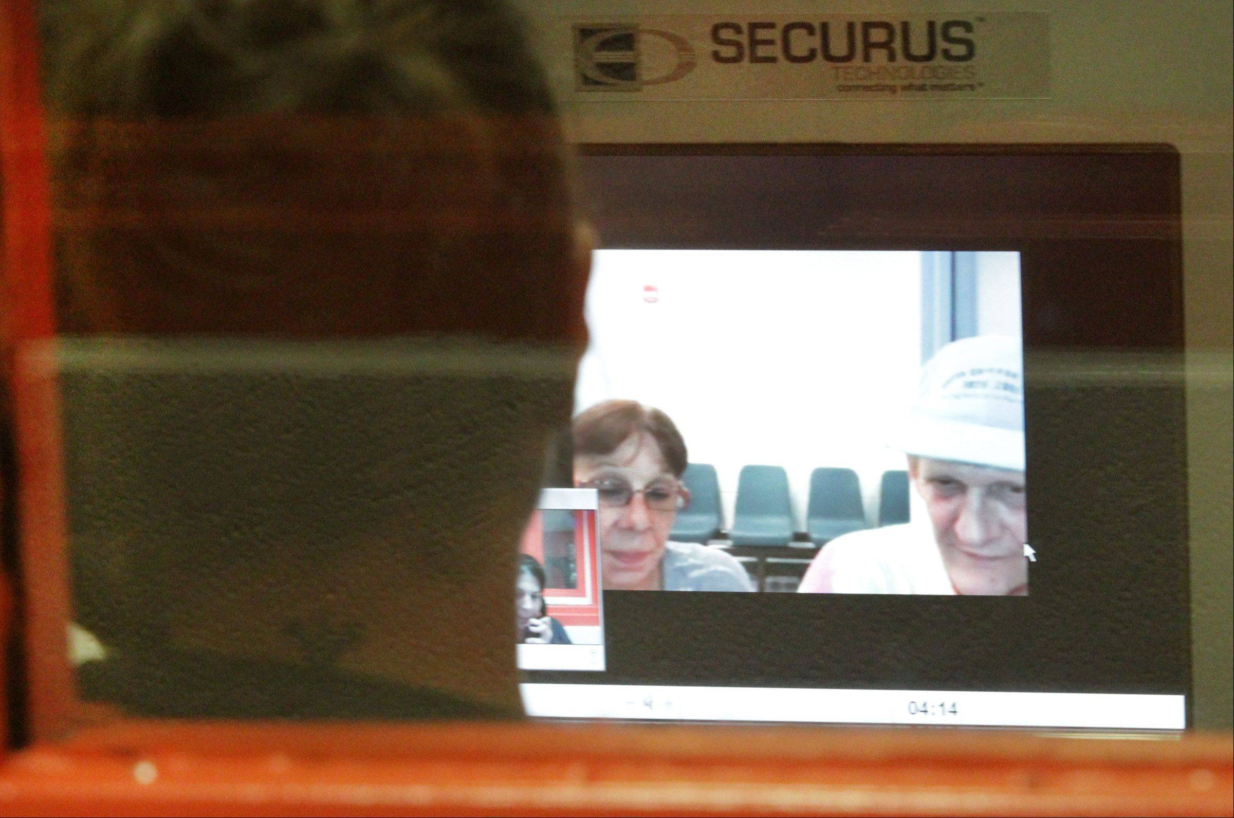 When she was an inmate at Lake County jail in Waukegan, Beth Coleman of Zion used Skype to speak with her parents Ann and Mark Van Sickle of Zion.