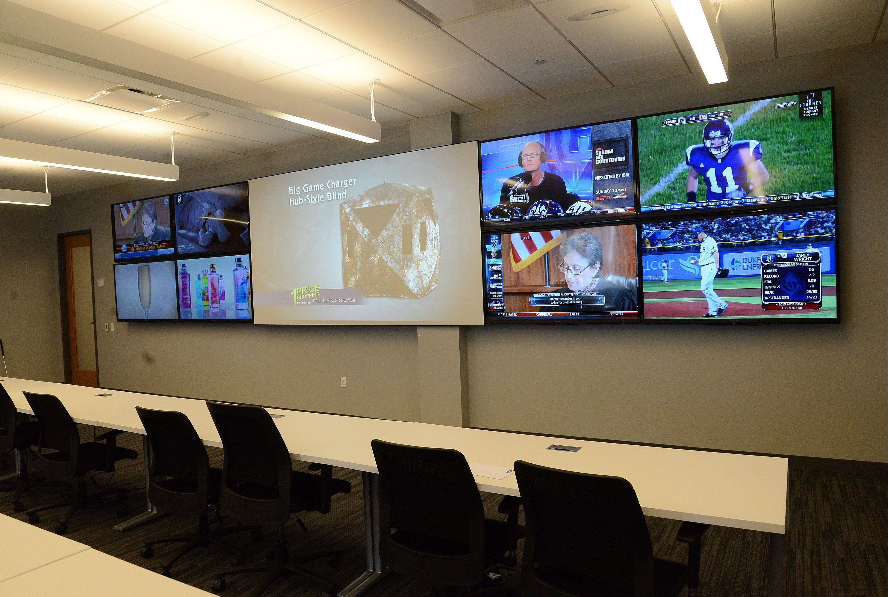 The Big Ten's video command center allows the conference's coordinator of officials and staff to watch all games simultaneously on nine TV screens.