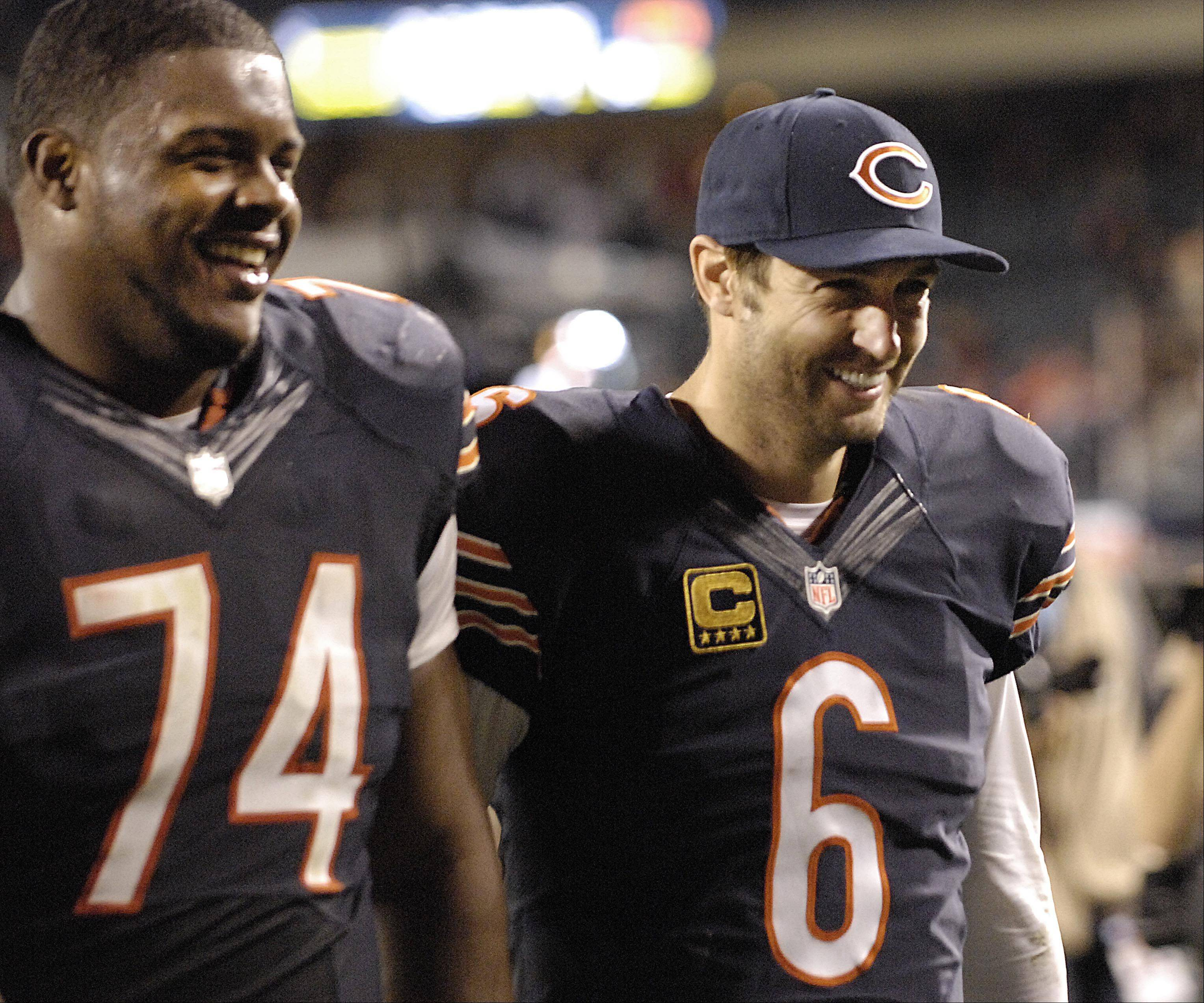 Bears quarterback Jay Cutler laughs with Jermon Bushrod as they leave the field following Thursday's victory over the New York Giants at Soldier Field.