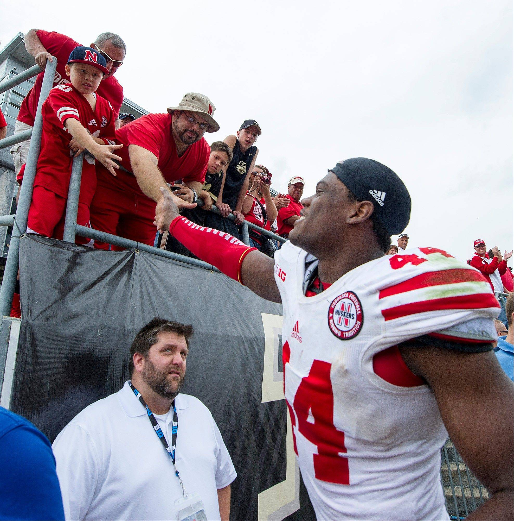 Nebraska's Randy Gregory celebrates with fans as he leaves the field after a big win over Purdue on Saturday in West Lafayette, Ind.