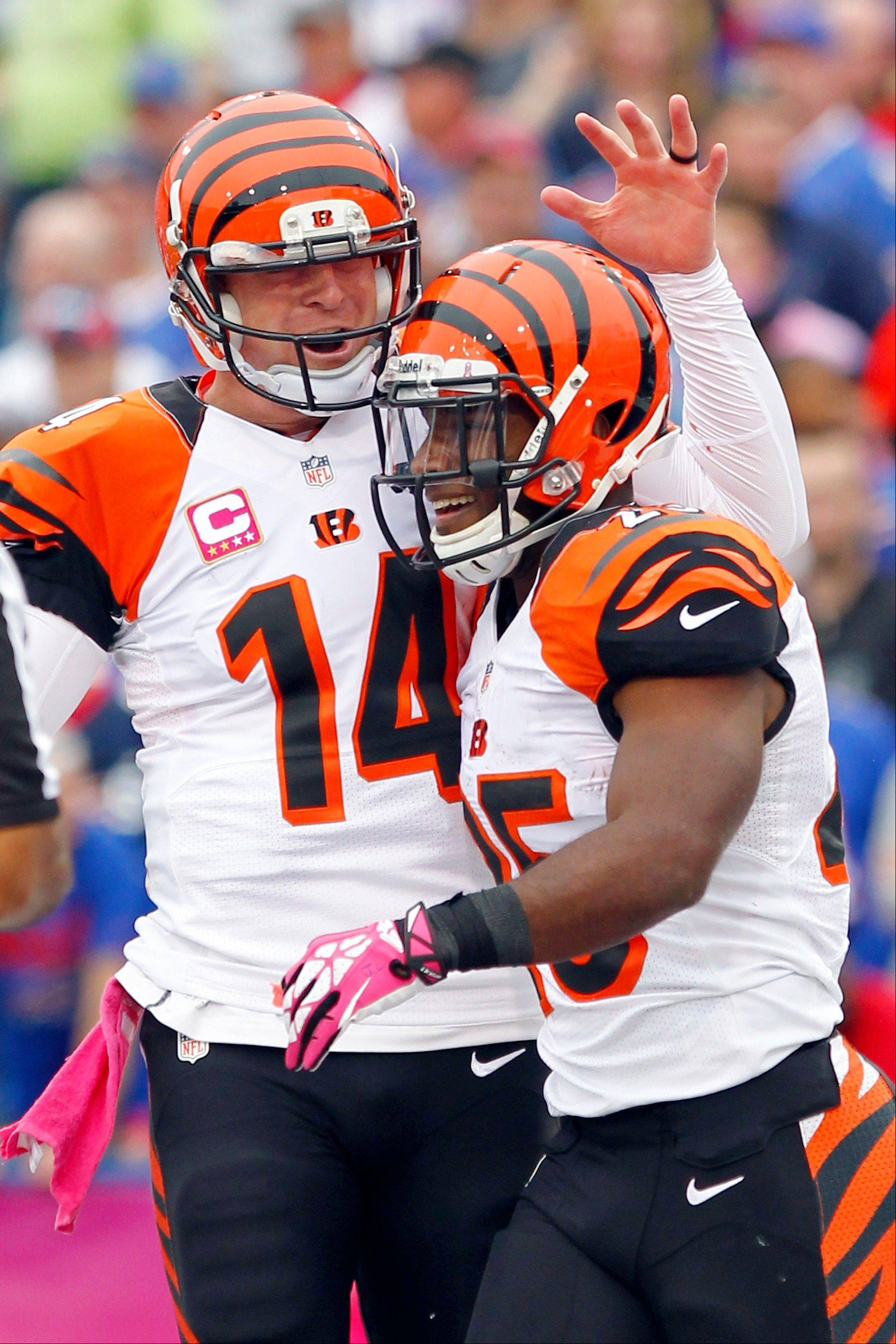 Cincinnati Bengals running back Gio Bernard (25) is greeted by quarterback Andy Dalton (14) after scoring against the Buffalo Bills in the third quarter of Sunday's game in Orchard Park, N.Y.