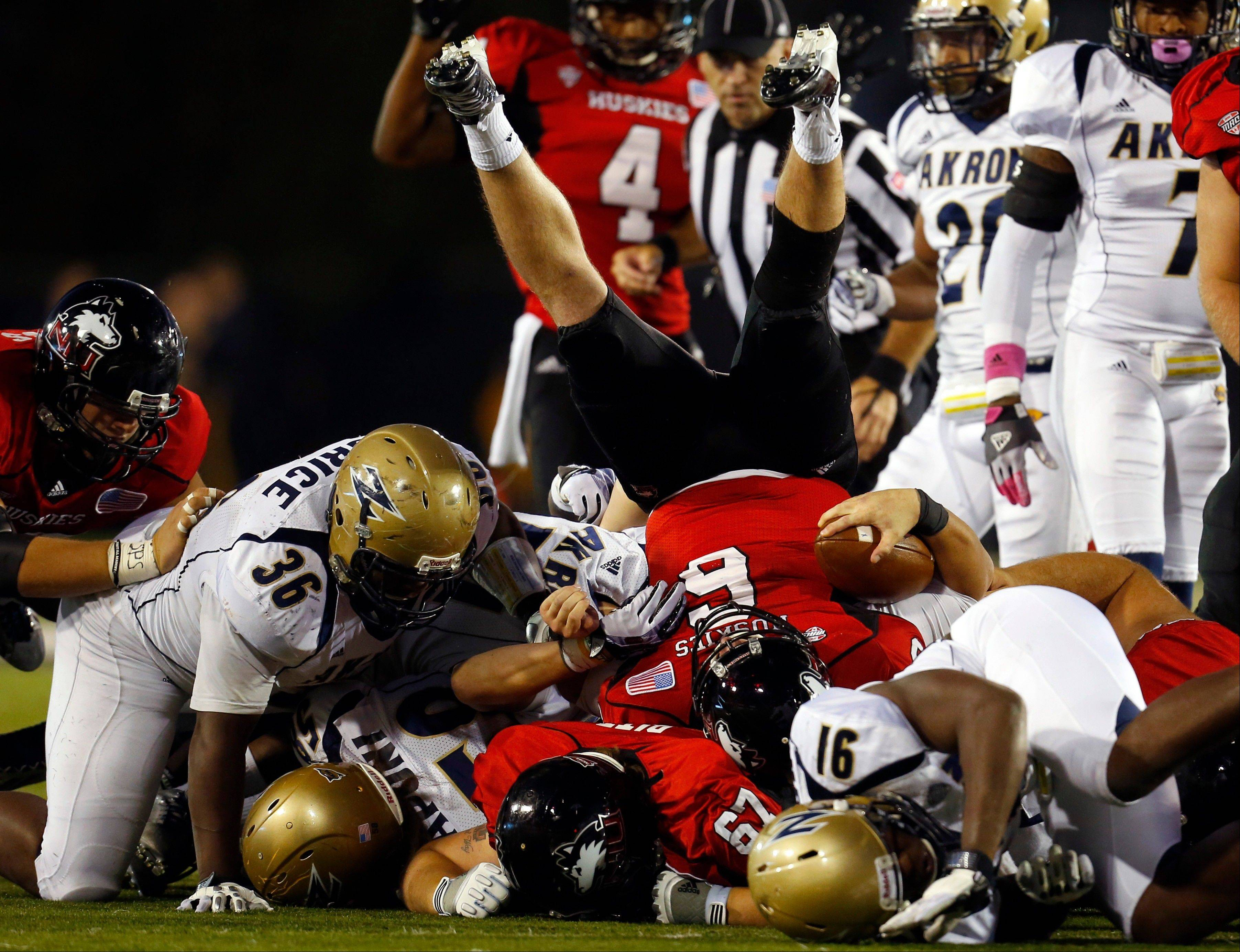 Northern Illinois quarterback Jordan Lynch (6) rolls back over the pile during Saturday's homecoming win over Akron.