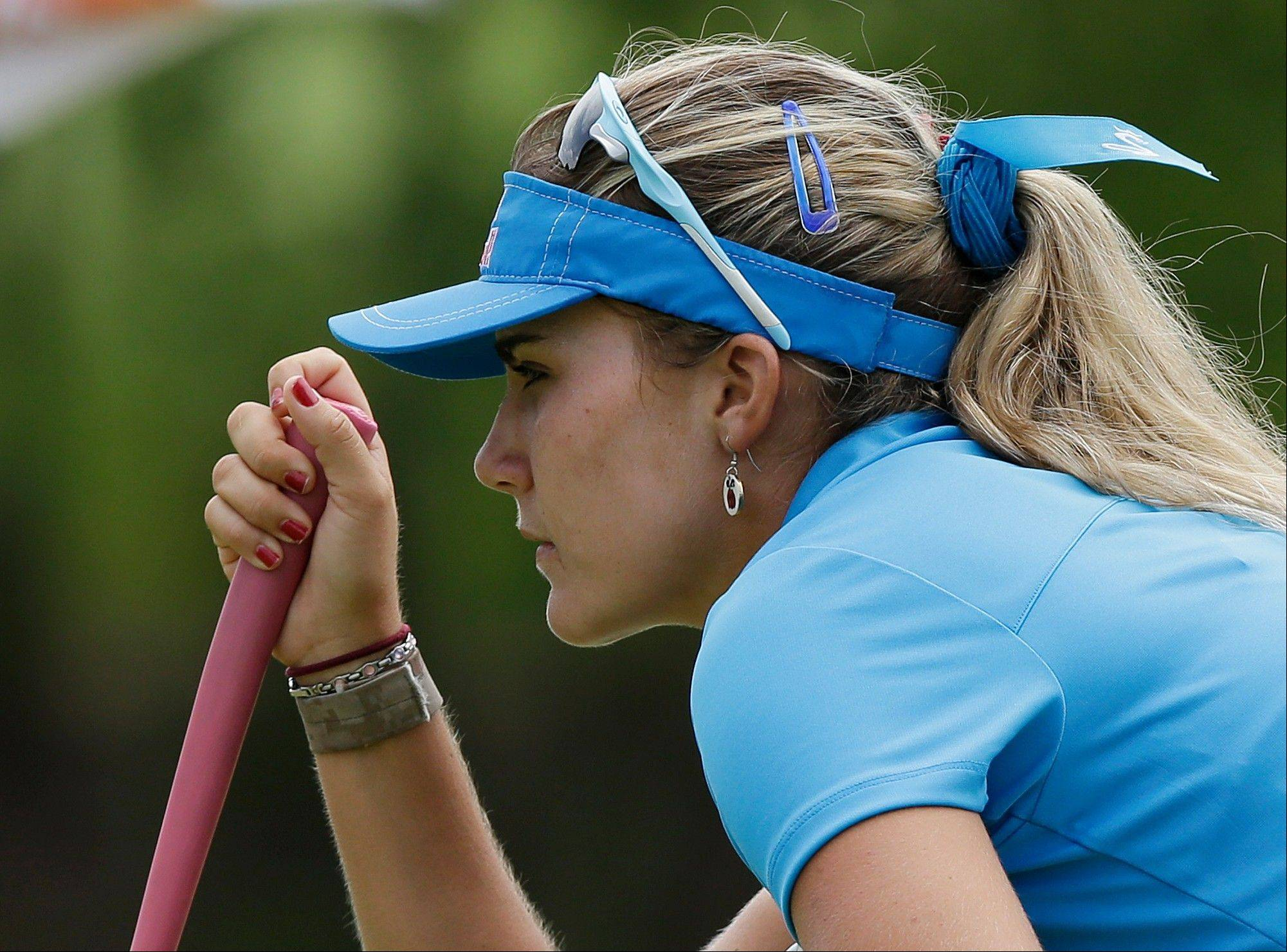 Lexi Thompson lines up a putt during her final round at the Malaysian LGPA event Sunday in Kuala Lumpur.