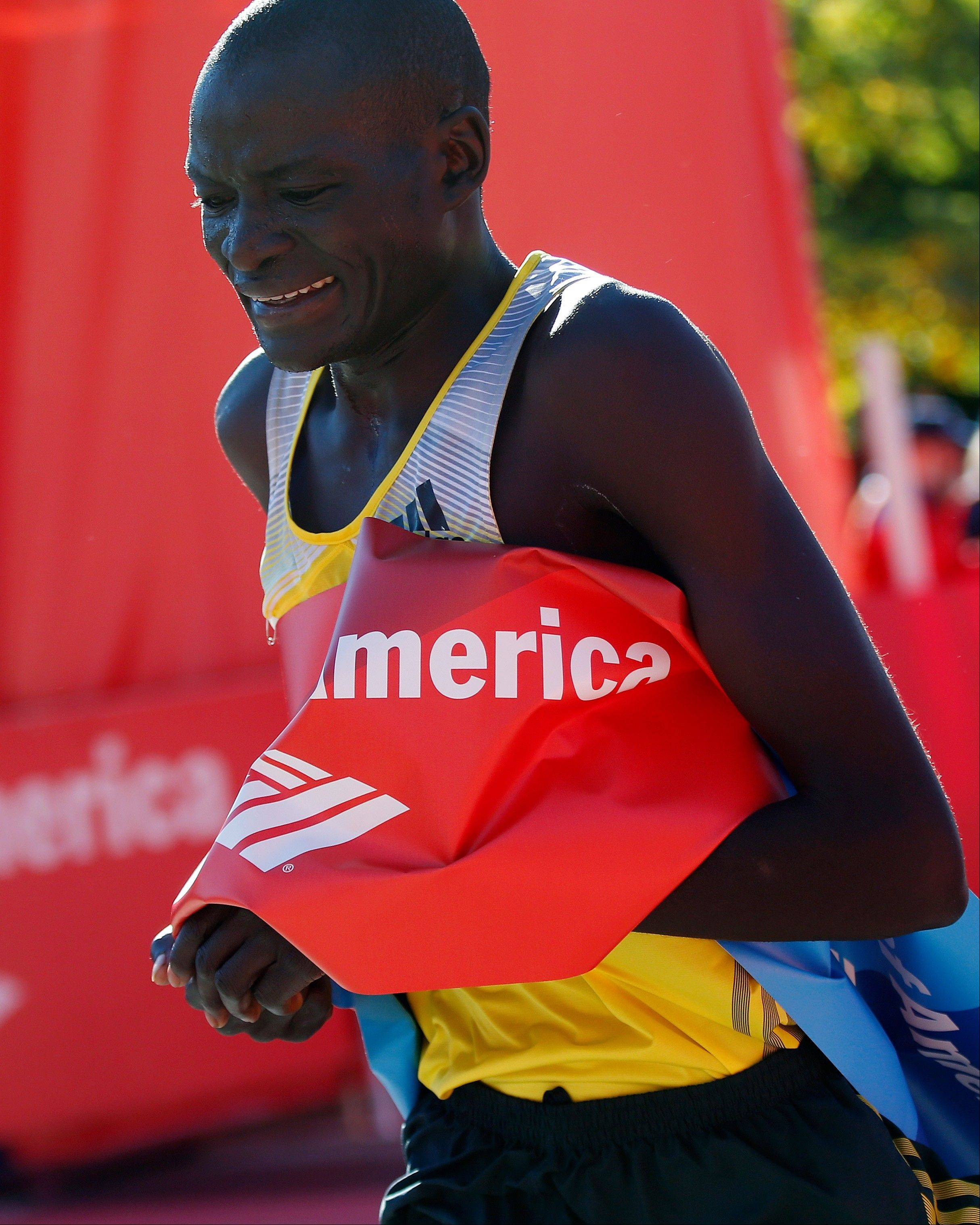 Dennis Kimetto of Kenya crosses the finish line to win the Chicago Marathon on Sunday in record time.