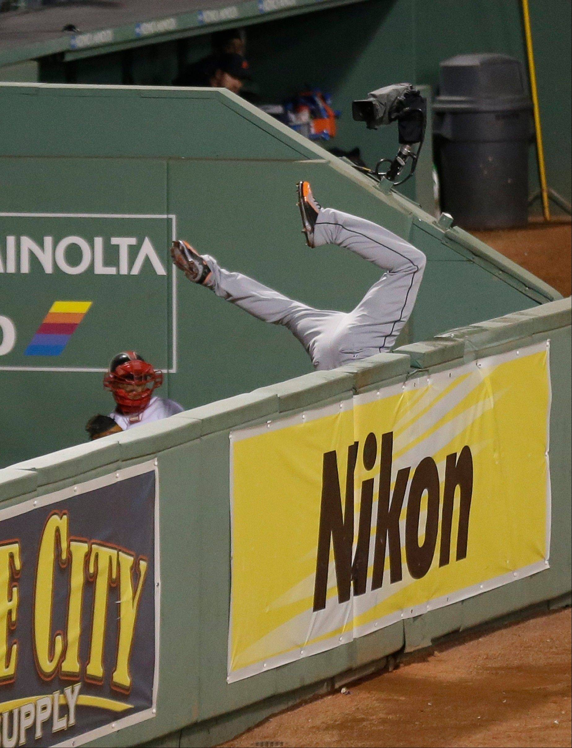 Detroit Tigers' Torii Hunter leaps and misses a catch as Boston Red Sox's David Ortiz hits a grand slam home run in the eighth inning during Game 2 of the American League baseball championship series Sunday, Oct. 13, 2013, in Boston.