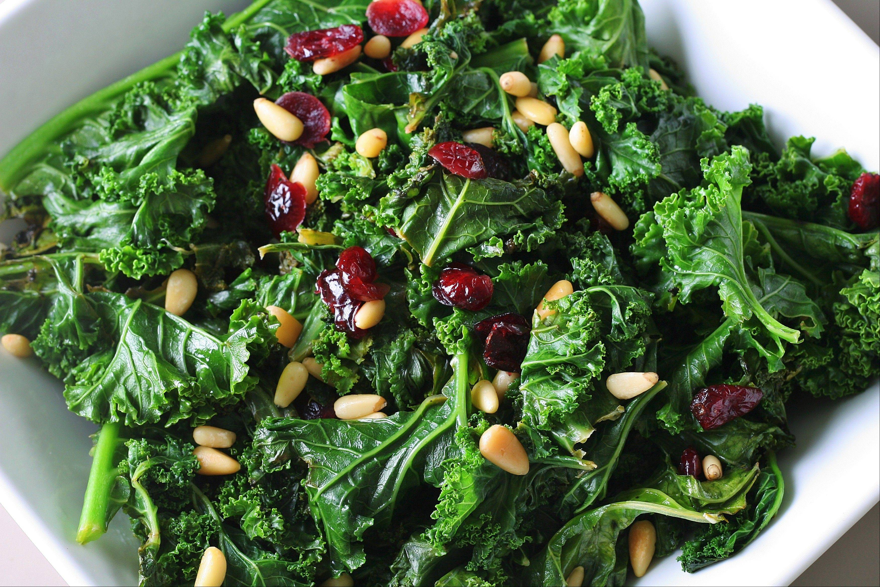 Sauteing kale with cranberries and pine nuts is a creative way to eat the super veggie.