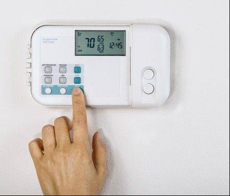 One way to cut your energy costs is to lower your thermostat.