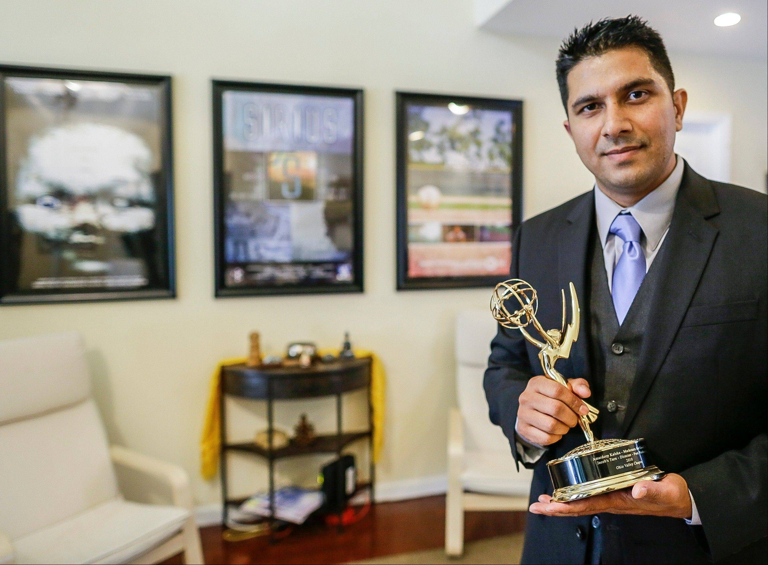 In this Thursday, Oct. 10, 2013 photo, film director and producer Amardeep Kaleka poses for a photo at Neverending Light, his Emmy Award winning film and television production company in Los Angeles. Kaleka, whose father Satwant Singh Kaleka, the president of the Sikh Temple of Wisconsin, was slain at the Oak Creek temple shooting in Milwaukee suburb in 2012, plans to challenge Rep. Paul Ryan in next year's congressional election. Kaleka says he'll file paperwork Wednesday to form an exploratory congressional committee. The 35-year-old Democrat plans to announce his candidacy formally next month.