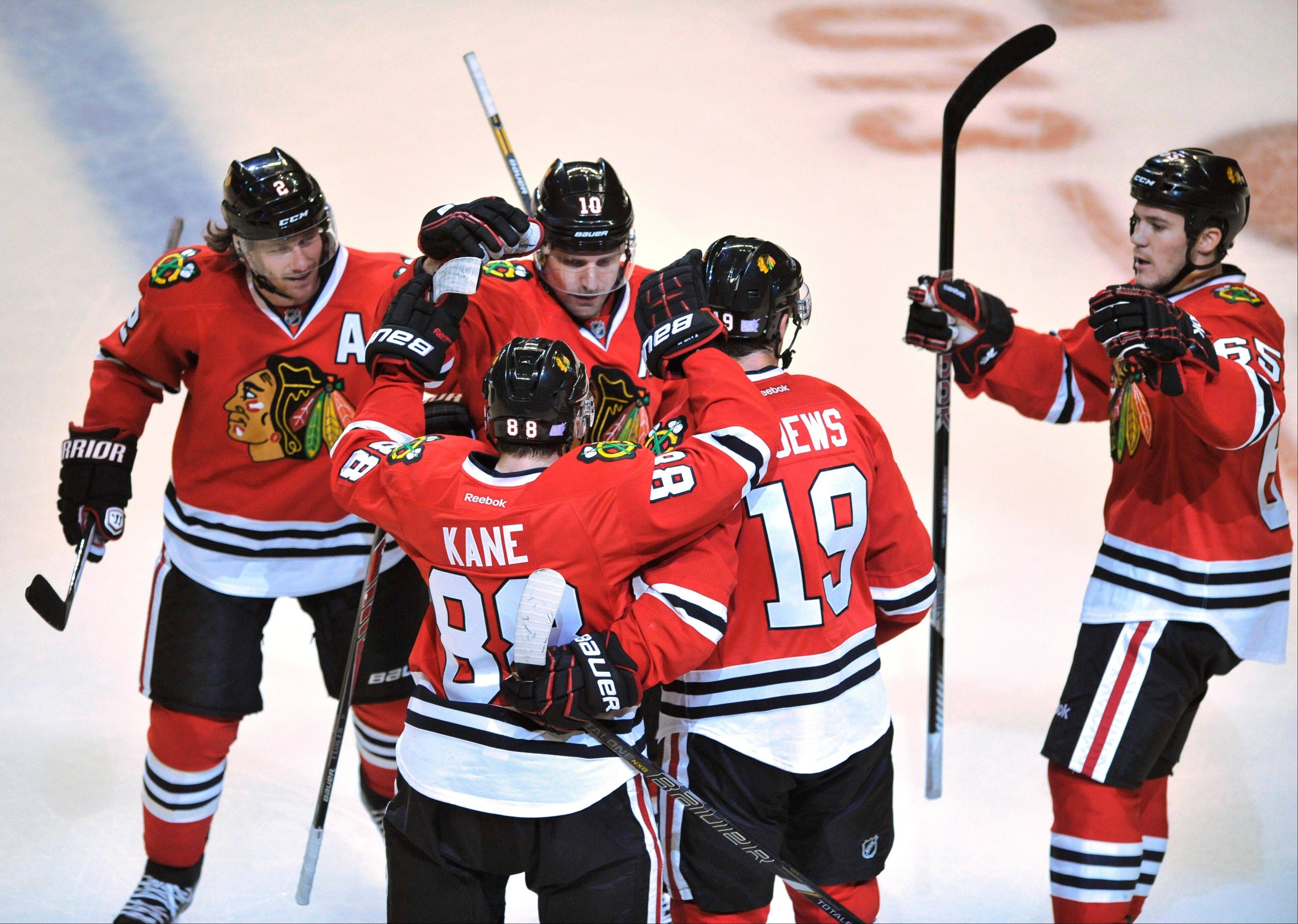 The Blackhawks' Patrick Kane (88), celebrates his goal with teammates Jonathan Toews (19), Andrew Shaw (65), Patrick Sharp (10), and Duncan Keith (2) during the second period Saturday against the Sabres at the United Center.