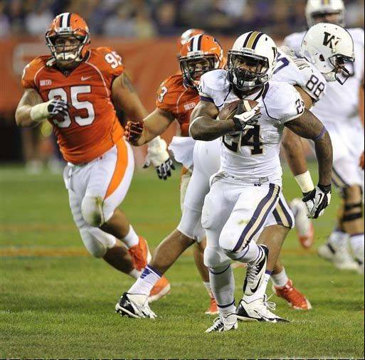 Washington�s Jesse Callier heads upfield and outruns the Illinois defense during the second half of the Sept. 14 game at Chicago�s Soldier Field. The Illini are surrendering almost 200 yards rushing per game and just shy of 450 yards a game in all.
