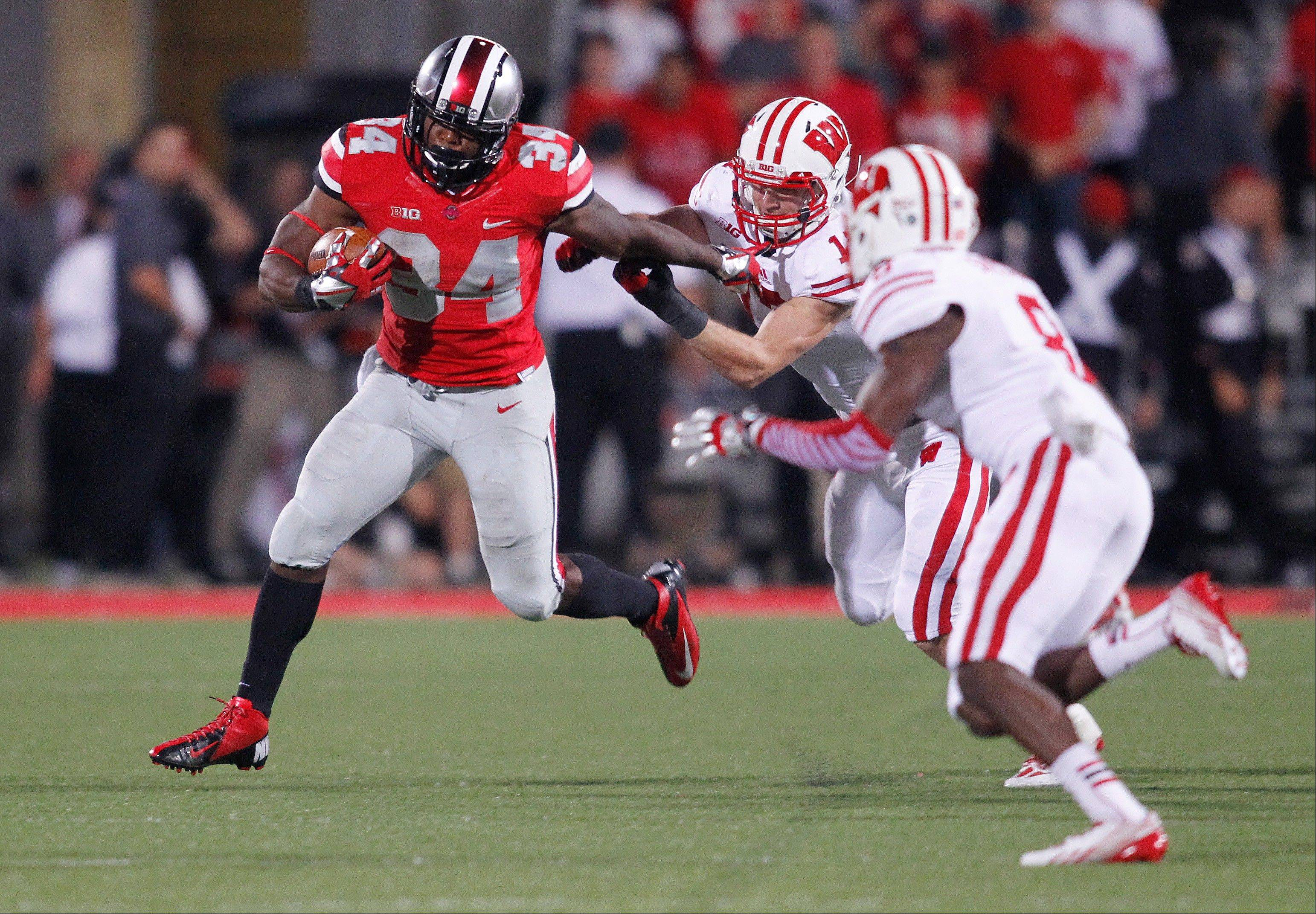 Ohio State running back Carlos Hyde tries to get around Wisconsin defenders during the fourth quarter of the Sept. 28 game in Columbus, Ohio. After a long weekend at home over the bye week, Hyde and the Buckeyes are getting serious heading into Saturday�s home game against Iowa.