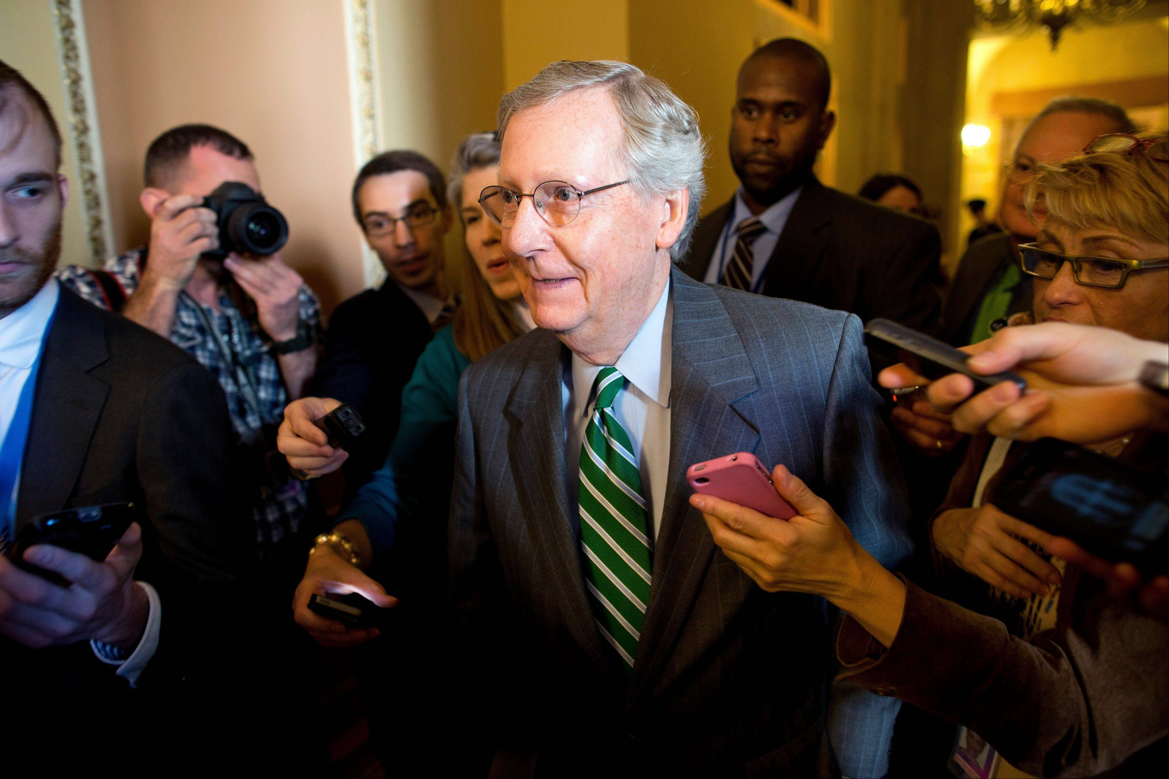 Senate Minority Leader Sen. Mitch McConnell, a Kansas Republican, is surrounded by reporters Monday as he walks to the Senate floor after meeting with Senate Majority Leader Sen. Harry Reid in Washington.