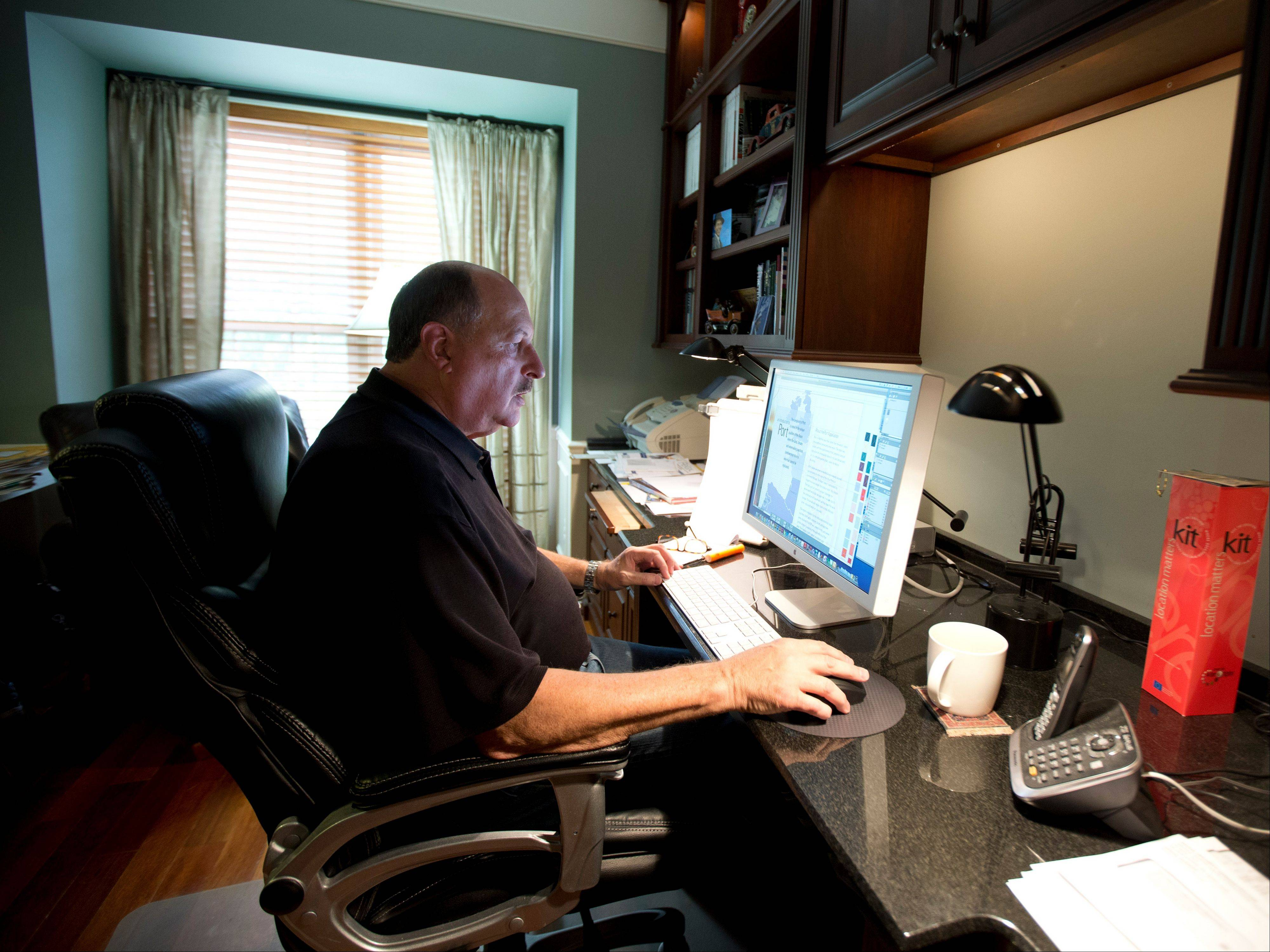 Graphic designer Tom Sadowski, 65, who delayed his retirement, works from home in Sterling, Va. Older Americans appear to have accepted the reality of a retirement that comes later in life and no longer represents a complete exit from the workforce.