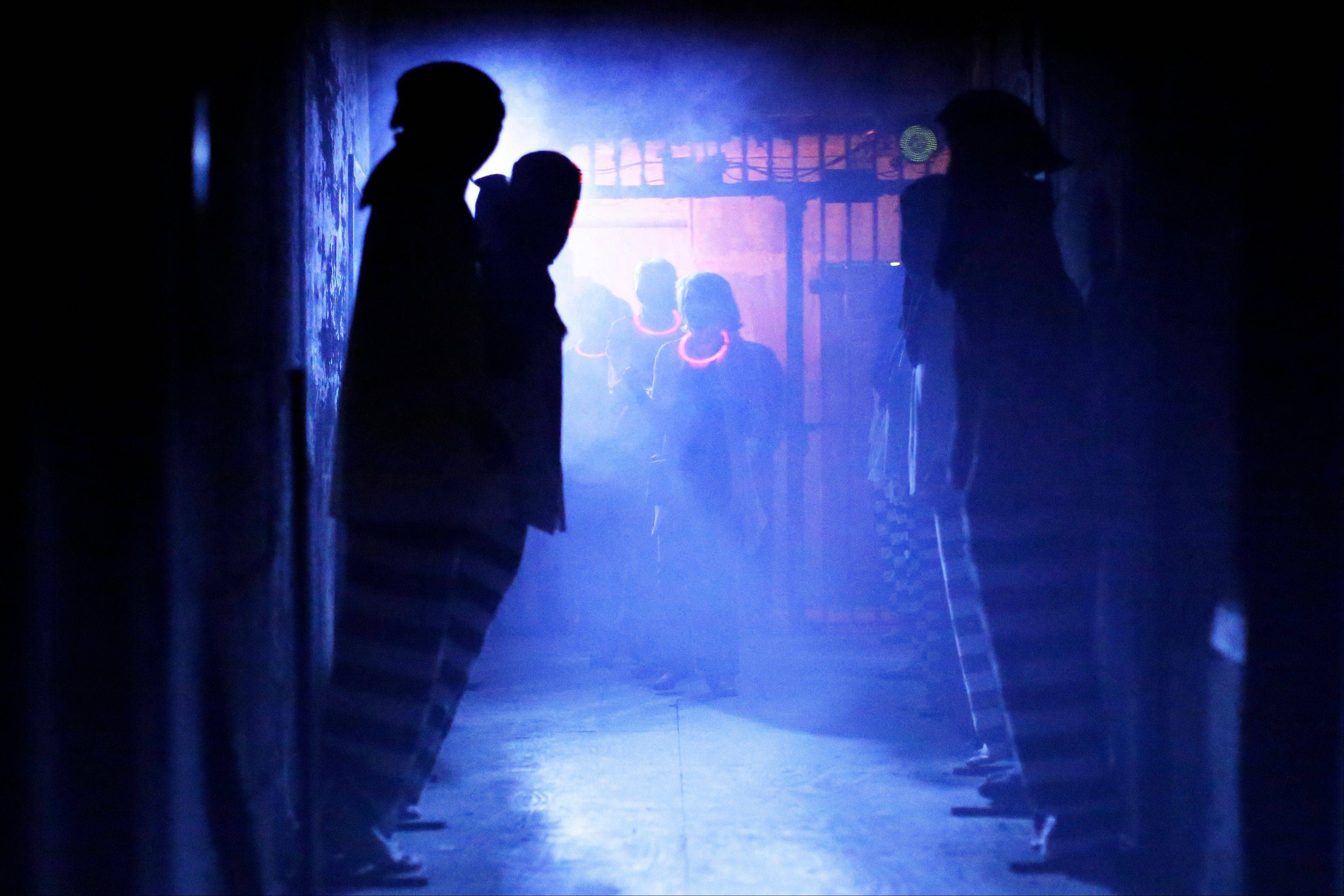 Visitors walk through a corridor during the Halloween haunted house, Terror Behind the Walls, at Eastern State Penitentiary in Philadelphia.