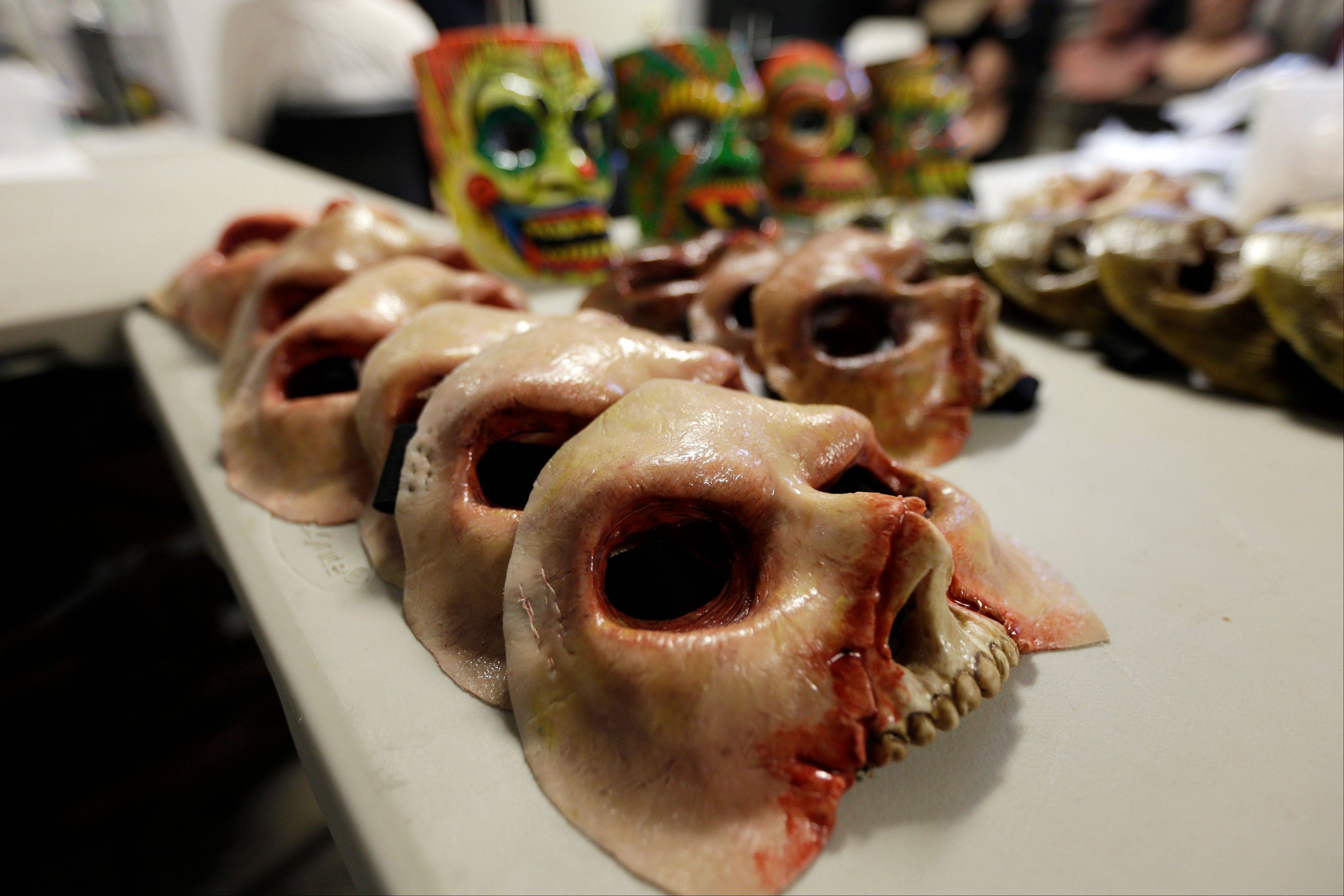 Masks await actors in the makeup room behind the scenes at Terror Behind the Walls. The haunted house is scheduled to run through Nov. 9.
