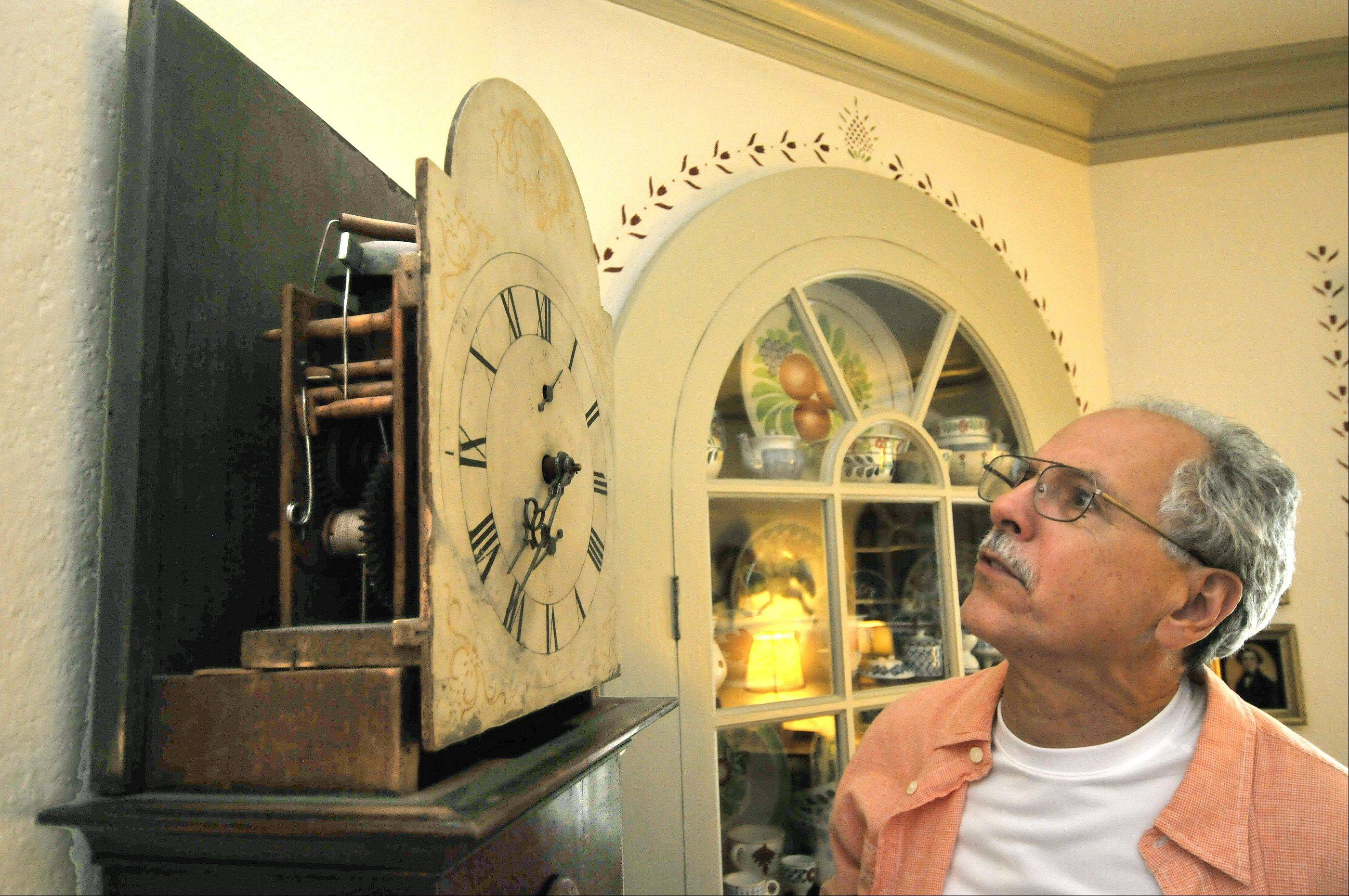 The Larsens have collected more antiques than they can count, including this clock with a wooden mechanism.