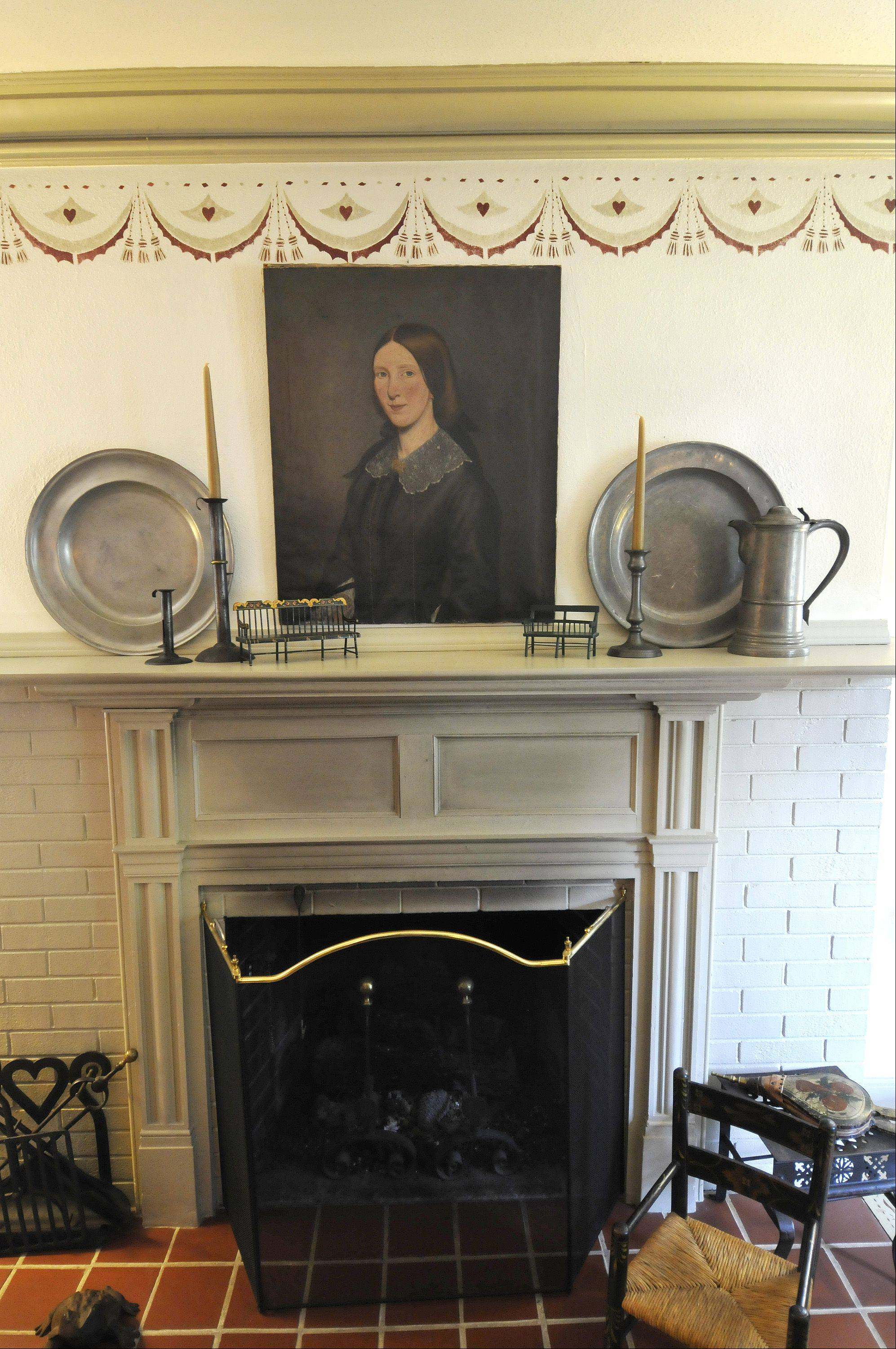 This mantelpiece in the Larsen home is from about 1850. The oil painting on canvas above it dates to about 1820.