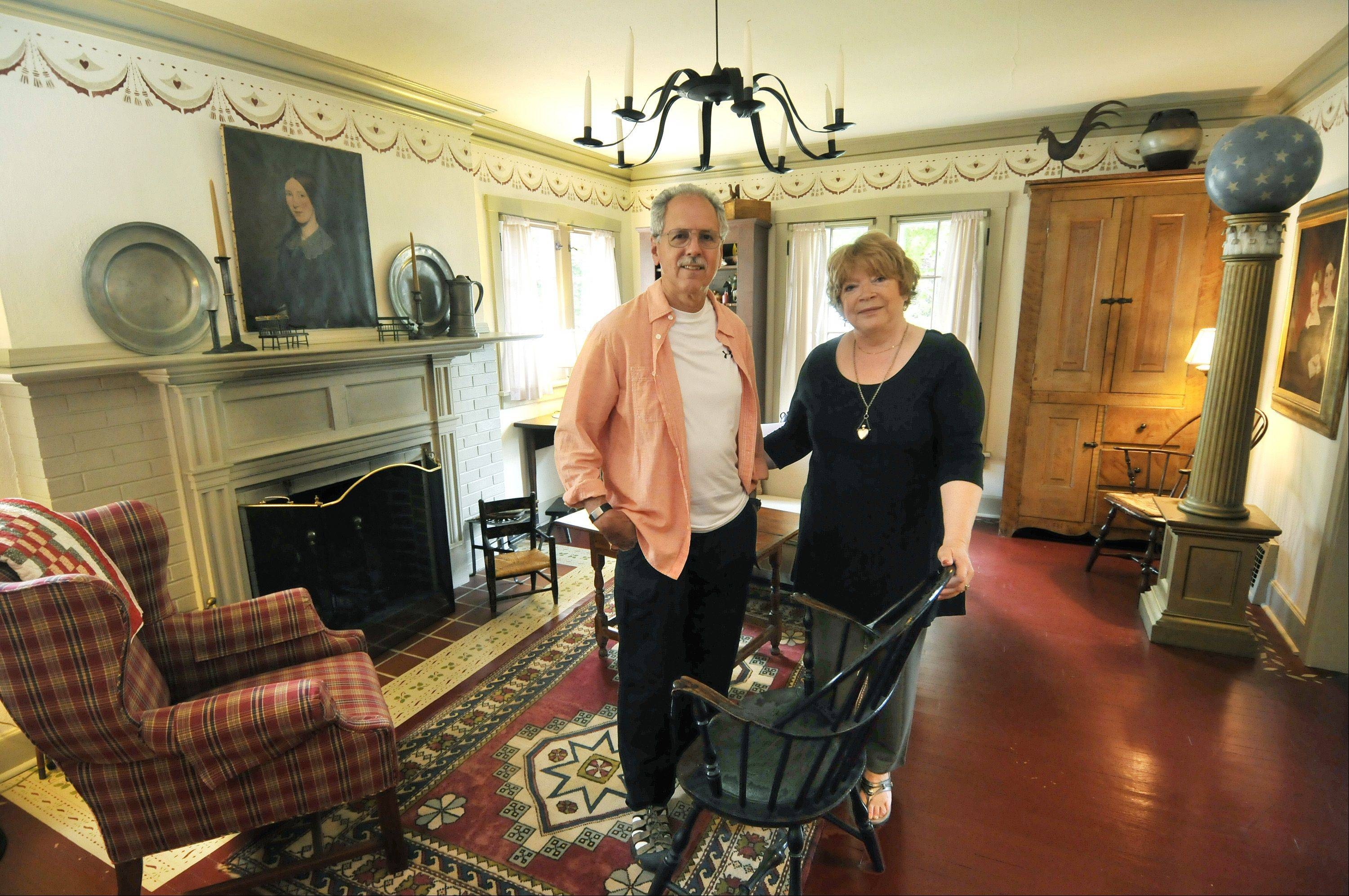 Glen Ellyn residents John and Ginny Larsen are antique dealers who also have a large collection of several thousand antiques in their home.