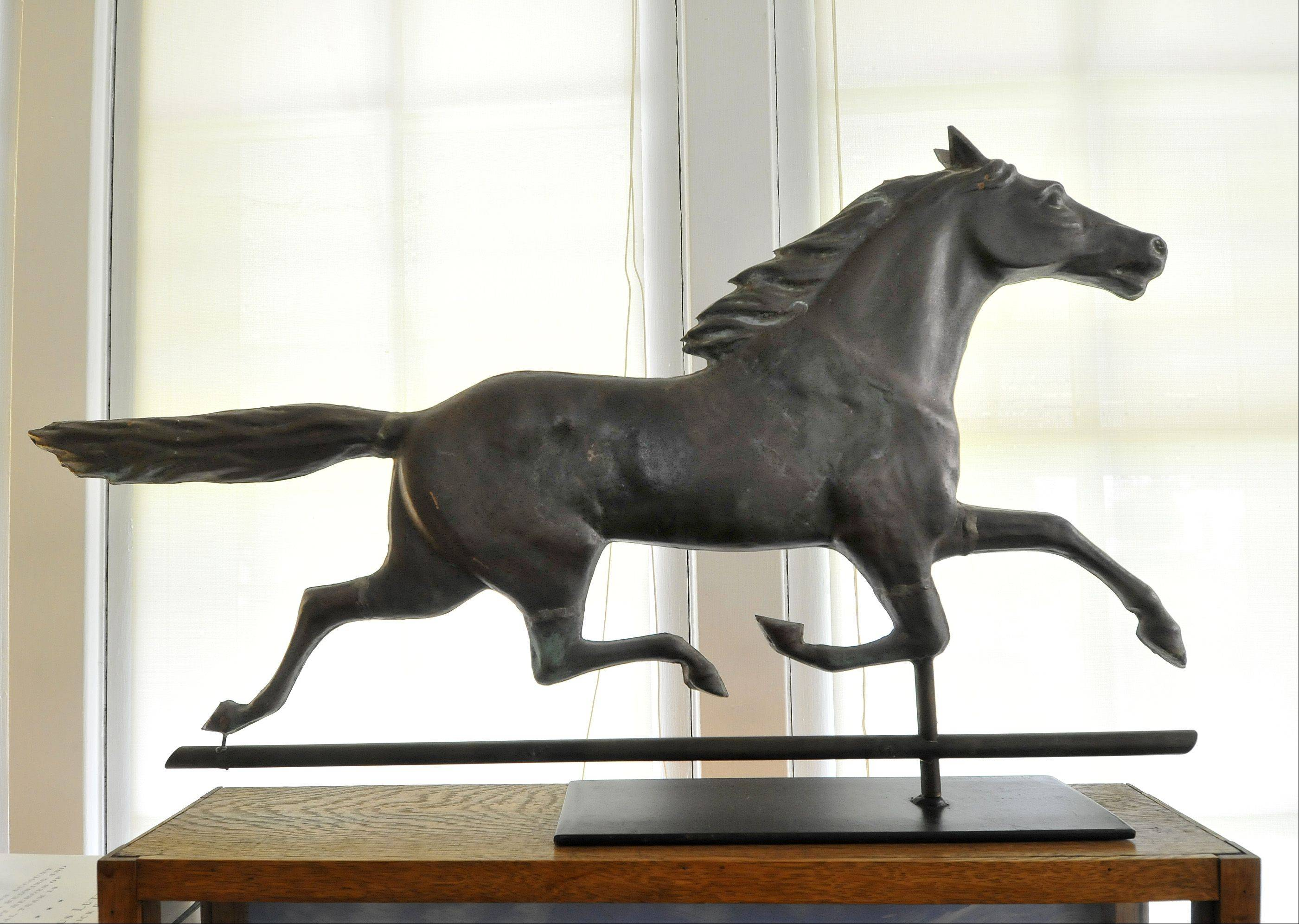 This Ethan Allen weather vane from about 1890 rests in the Larsen's kitchen, along with many other antiques from the 19th century.