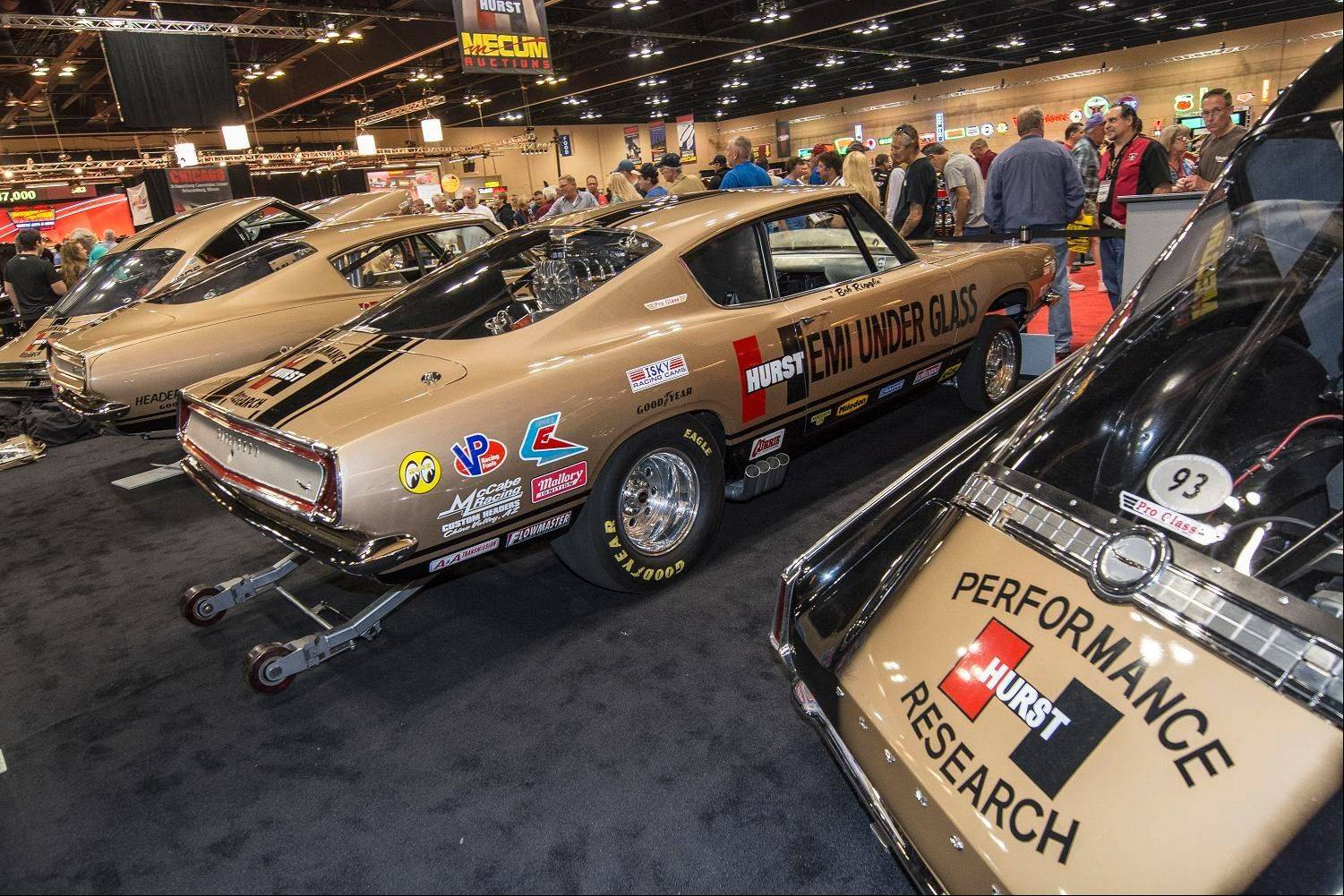 The auction featured four 1960s Plymouth Barracudas customized by the Hurst company.