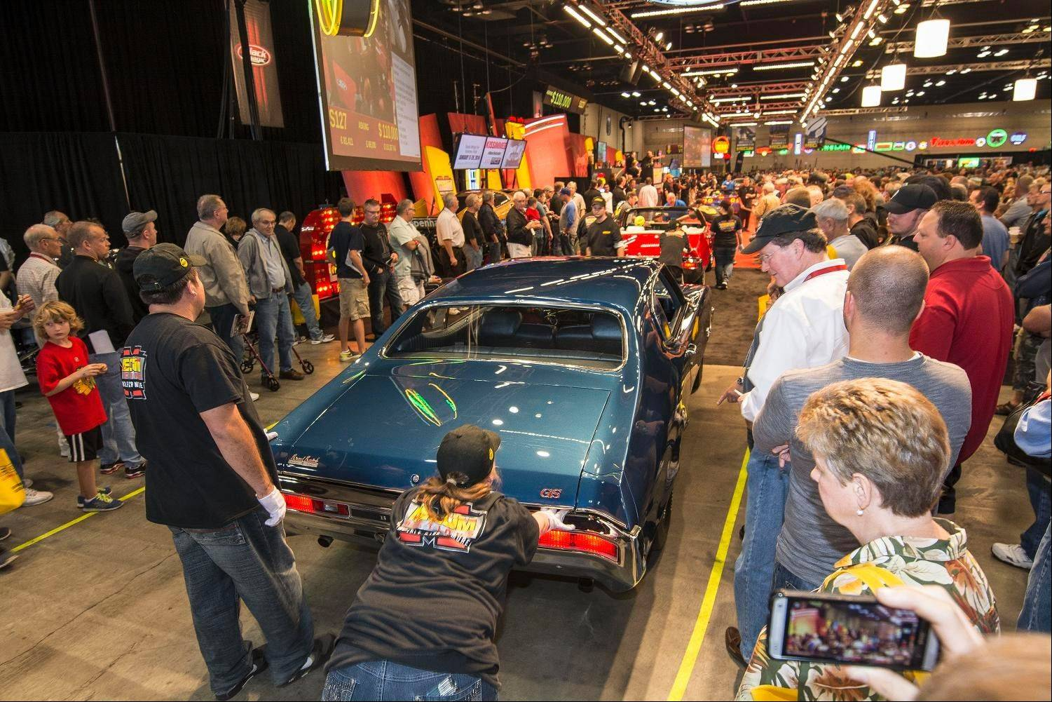 Mecum Auctions sold about 1,000 cars last weekend at the Schaumburg Convention Center