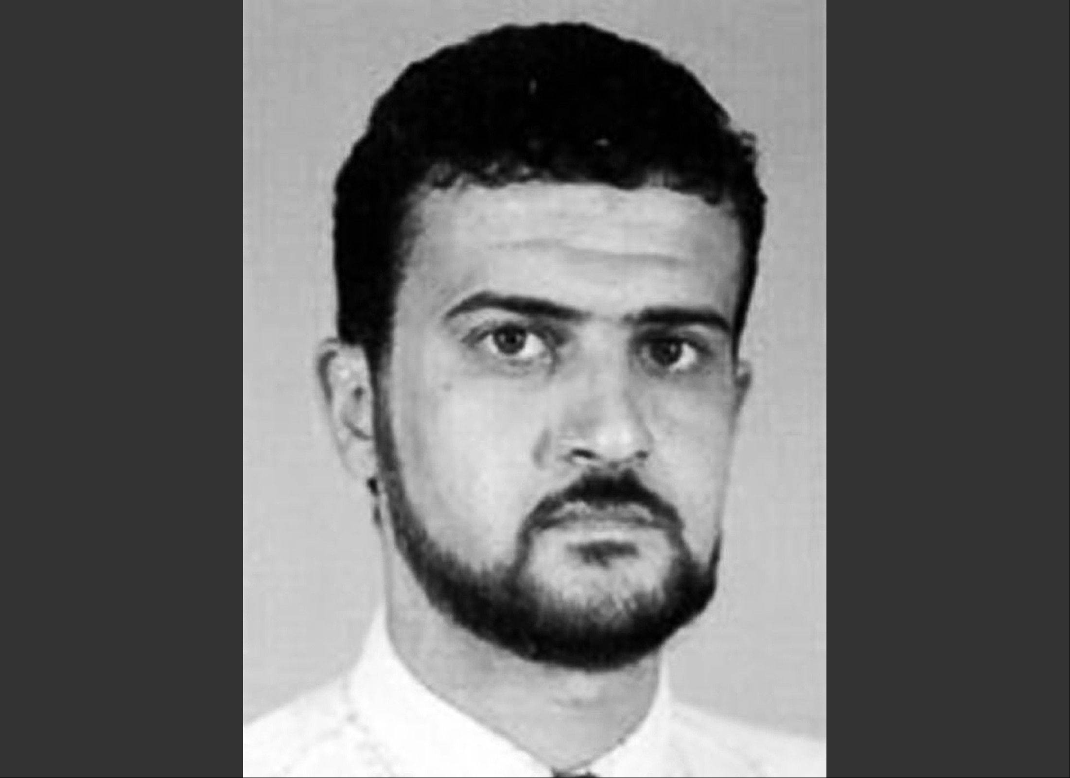 This file image from the FBI website shows al-Qaida leader Abu Anas al-Libi. Al-Libi, who was captured in an Oct. 5, 2013, raid and held aboard a U.S. warship, is now in the United States. He is expected to stand trial over whether he helped plan and conduct surveillance for the bombings of U.S. embassies in Africa in 1998.