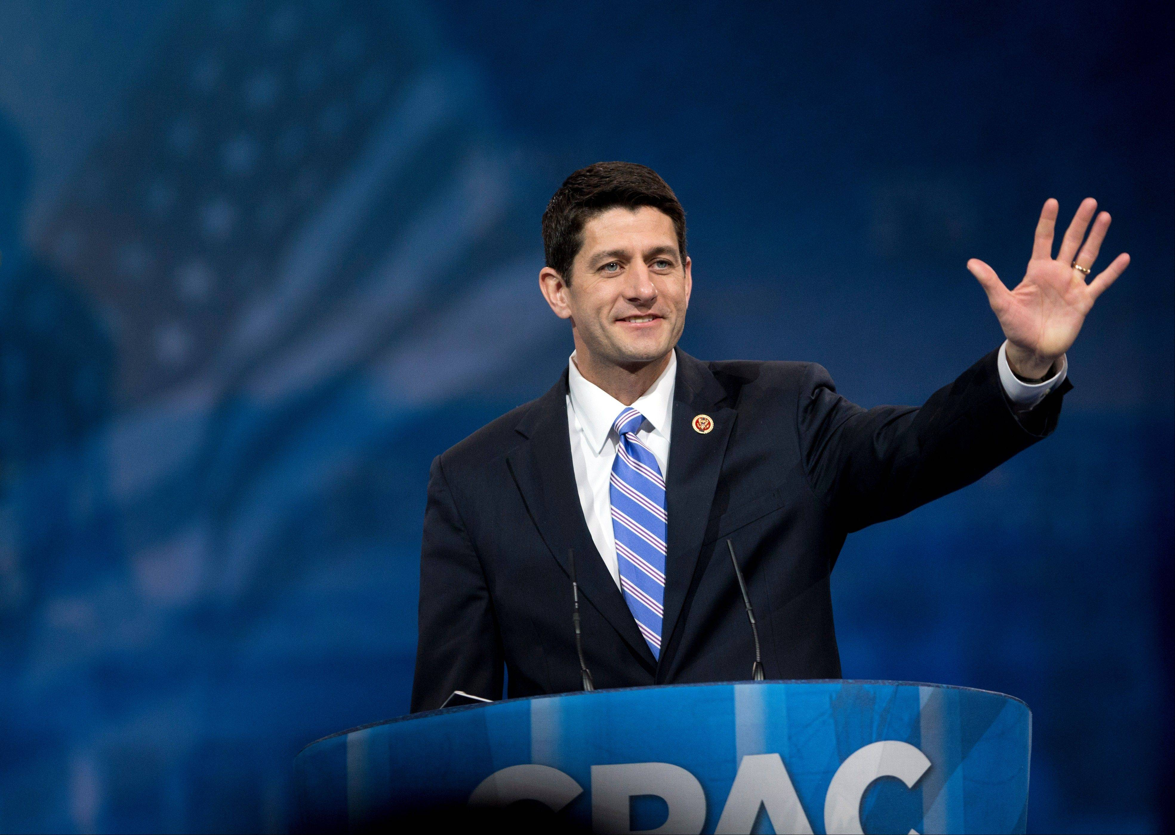 In this March 15, 2013, file photo, House Budget Committee Chairman, Rep. Paul Ryan, a Wisconsin Republican, waves as he arrives before speaking at the 40th annual Conservative Political Action Conference in National Harbor, Md.