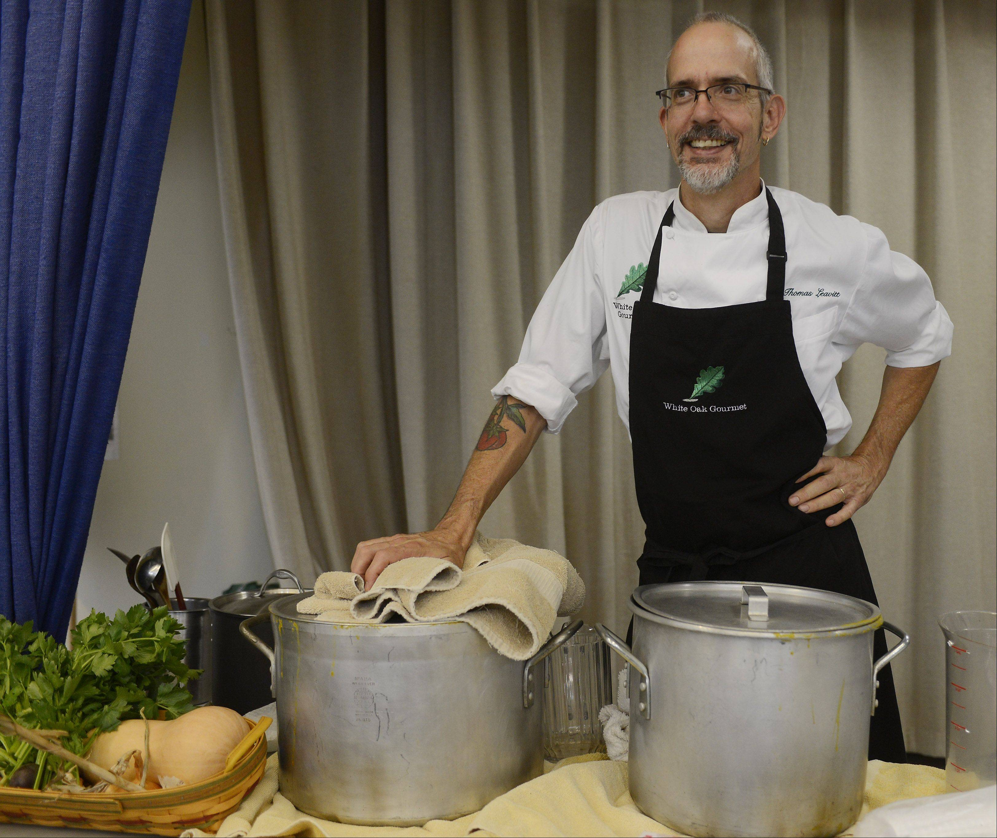 Chef Thomas Leavitt of White Oak Gourmet is ready to serve butternut squash soup, made from vegetables grown in the school's community garden.
