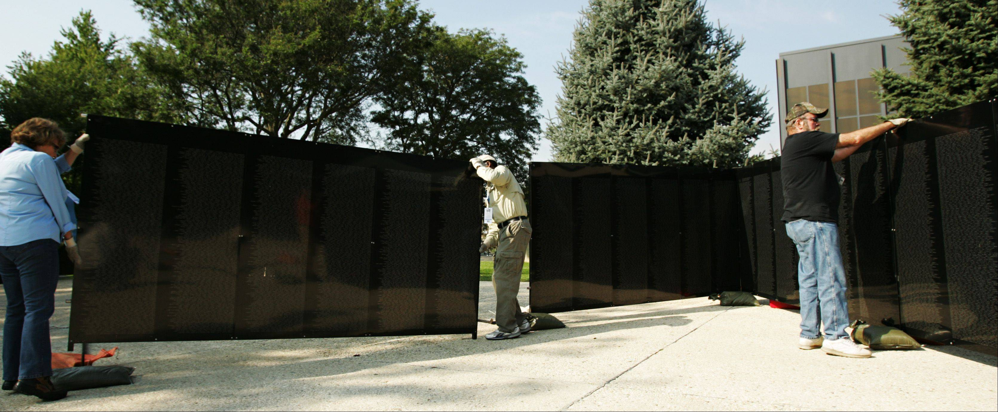 Several weeks ago the traveling Wall That Heals exhibit made a stop in downtown Elgin. It's a small-scale replica of the Vietnam Veterans Memorial in Washington, D.C. I was impressed with the volunteerism that went into the entire project - not just to set up the massive display, but what it took to stand watch over it 24 hours a day while it was here. This photo was published in the Perspective column in the print edition.