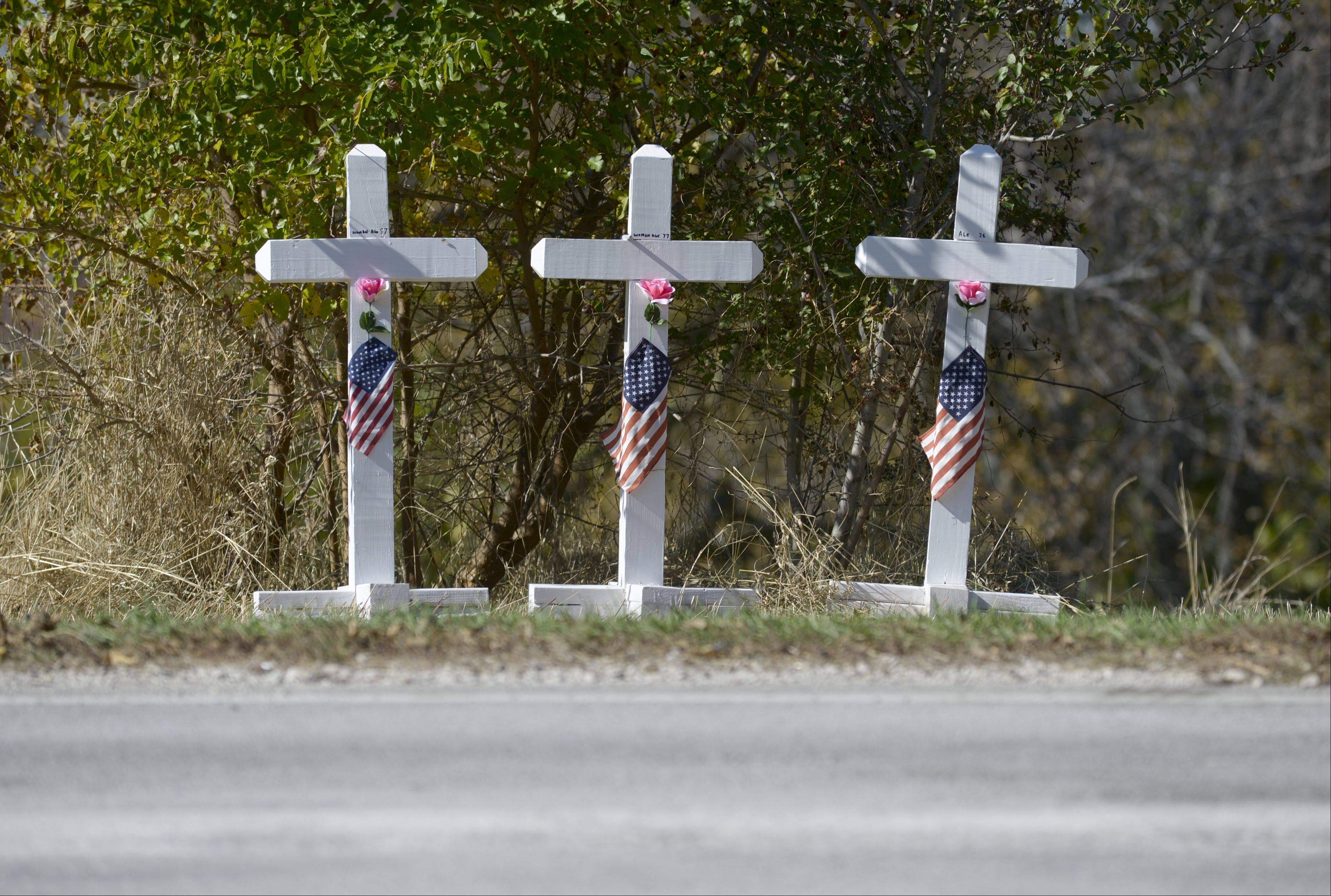 A memorial along Route 25 in Aurora marks the spot where three people were killed Sunday in a head-on collision.