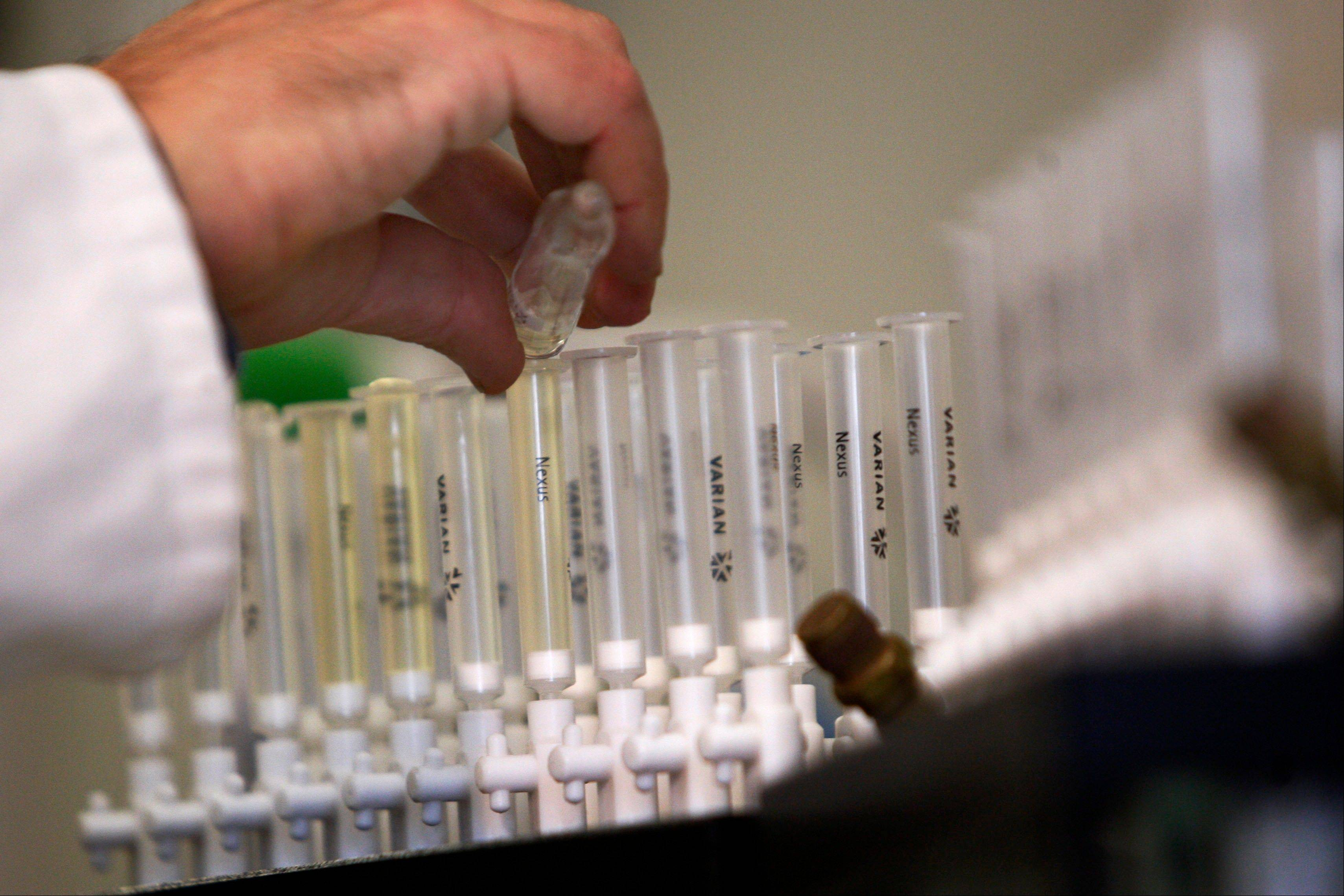 "A laboratory technician prepares samples of urine for doping tests during a media open day at the King's College London Drug Control Centre in London. The world�s anti-doping authority is launching an ""extraordinary"" audit of Jamaica's drug-testing agency following allegations that its policing of the island's sprinting superstars all but collapsed in the months before they dazzled at the London Games."