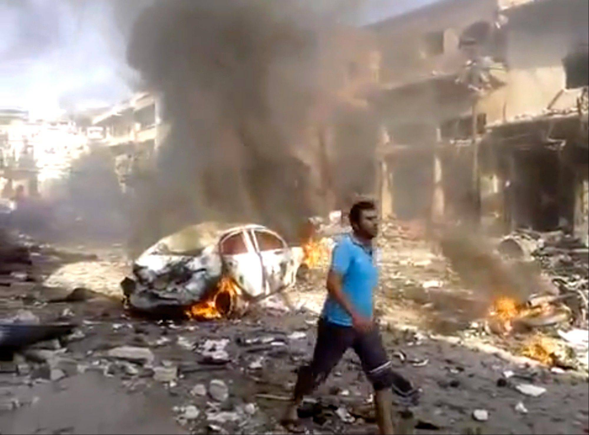A car bombing in a rebel-held northwestern town in Syria killed at least 15 people and wounded dozens on Monday, setting cars on fire and sending people running in panic, two activist groups said.