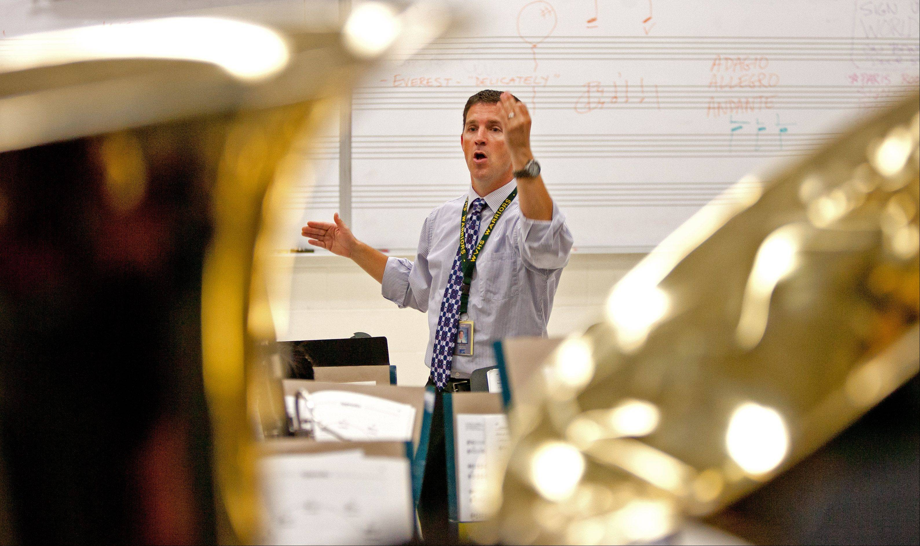 Mark Duker, fine arts department chairman at Waubonsie Valley High School, is one of 25 semifinalists for the first Grammy Award for music educators. He conducts the school's most prestigious band, Wind Ensemble, and helps ensure other music and art teachers have what they need to best instruct their students.