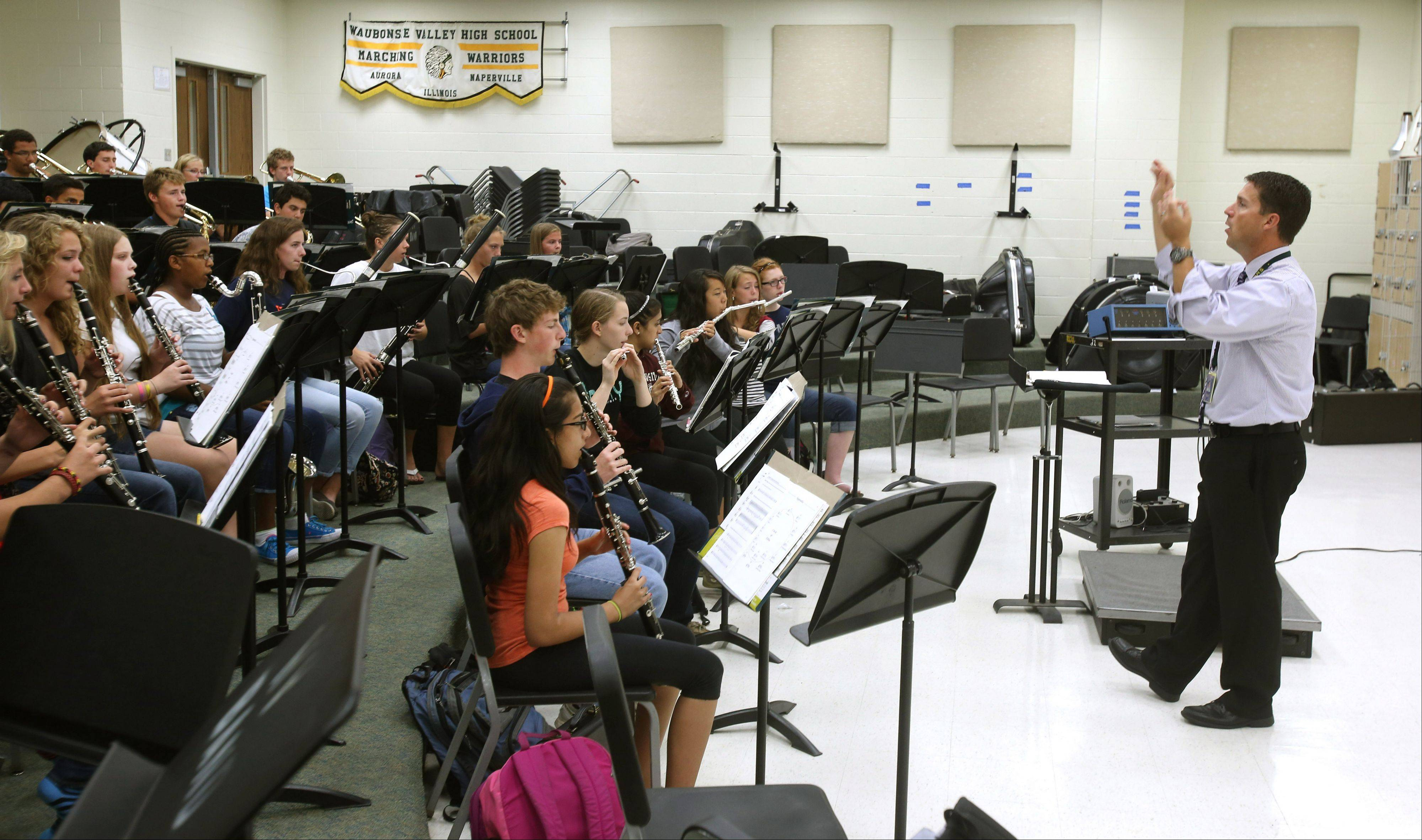 Waubonsie Valley High School Fine Arts Department Chairman Mark Duker conducts the school's Wind Ensemble. Duker has been nominated by two former students for the first Grammy Award for music educators, and he's in the running as a semifinalist.
