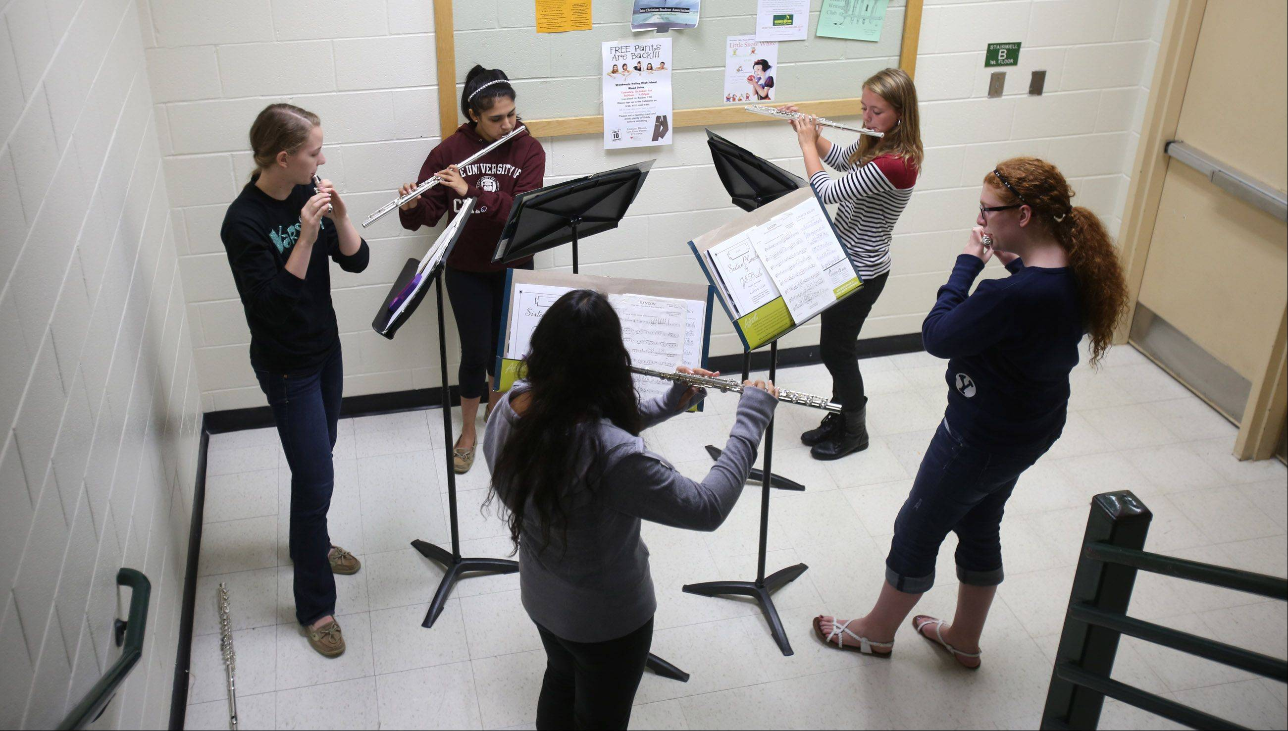 The Waubonsie Valley High School Wind Ensemble's flute players hold a sectional after a rehearsal led by Mark Duker, the school's fine arts department chairman, who is a semifinalist for the first Grammy award for music educators.