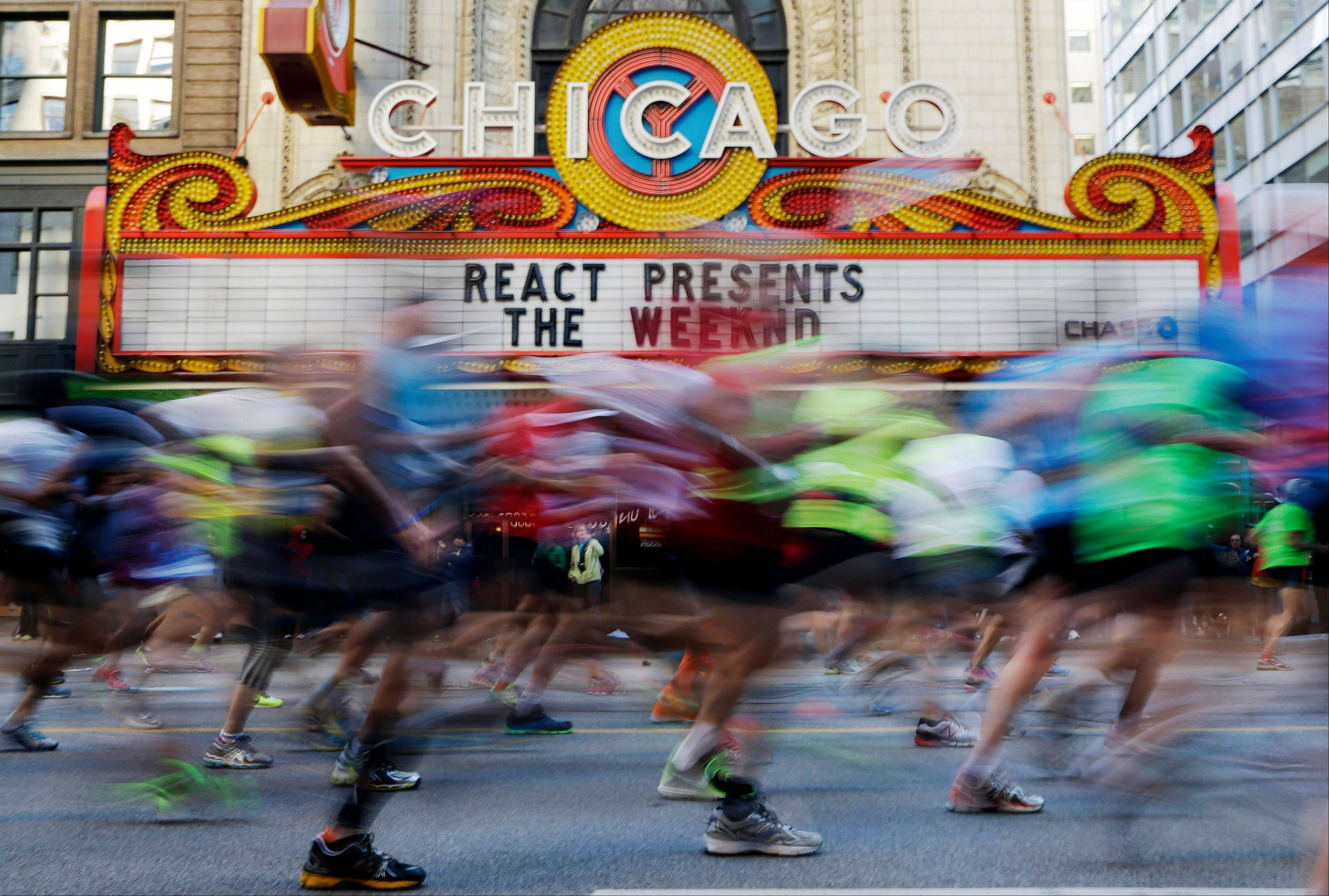 Runners participate in the Chicago Marathon in Chicago, Sunday, Oct. 13, 2013, nearly six months after the Boston Marathon bombings, with more police officers lining race routes and spectator areas.