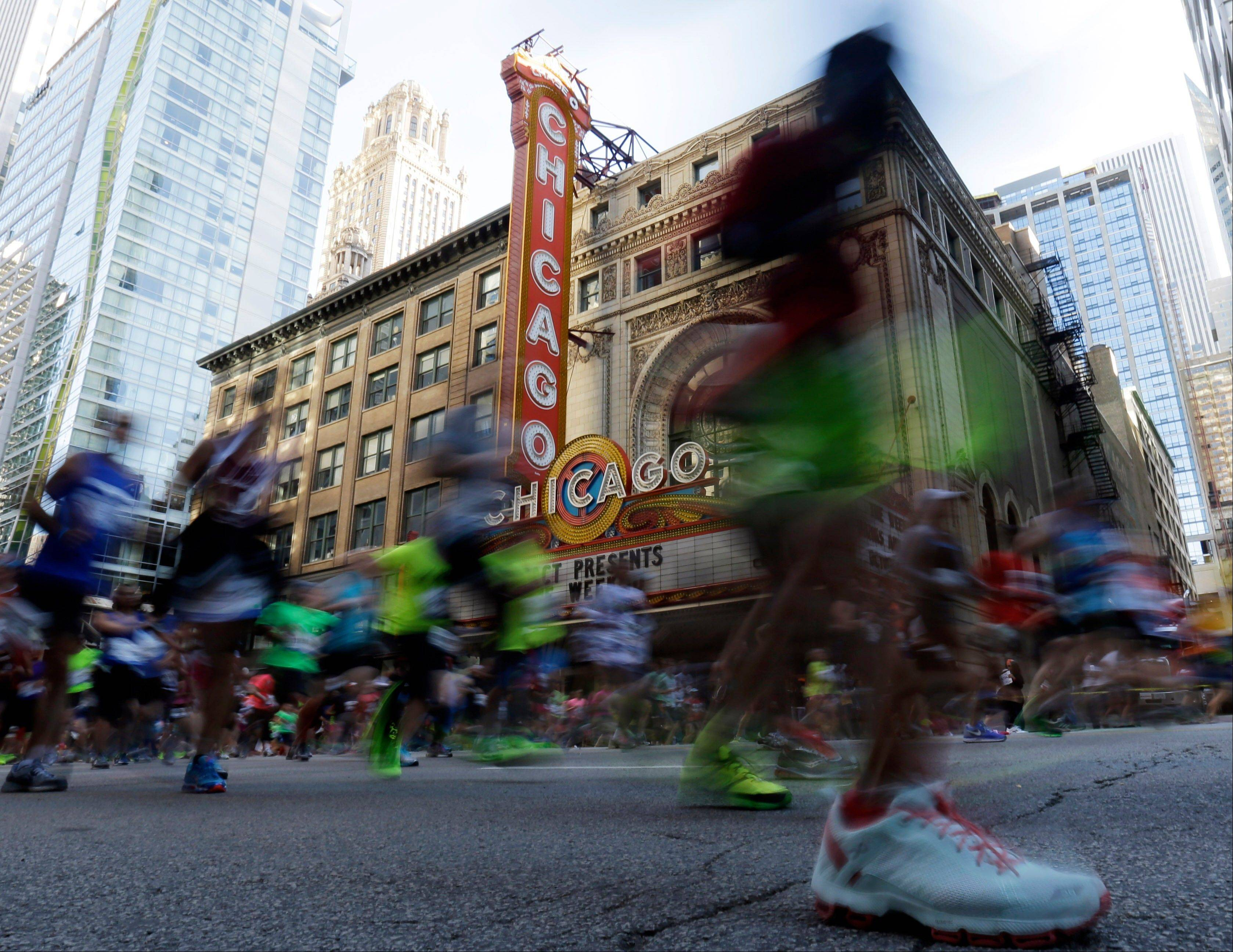 Runners make their way along the 26.2 mile route in the Chicago Marathon Sunday in Chicago. Organizers say 40,230 athletes took part in the annual marathon.