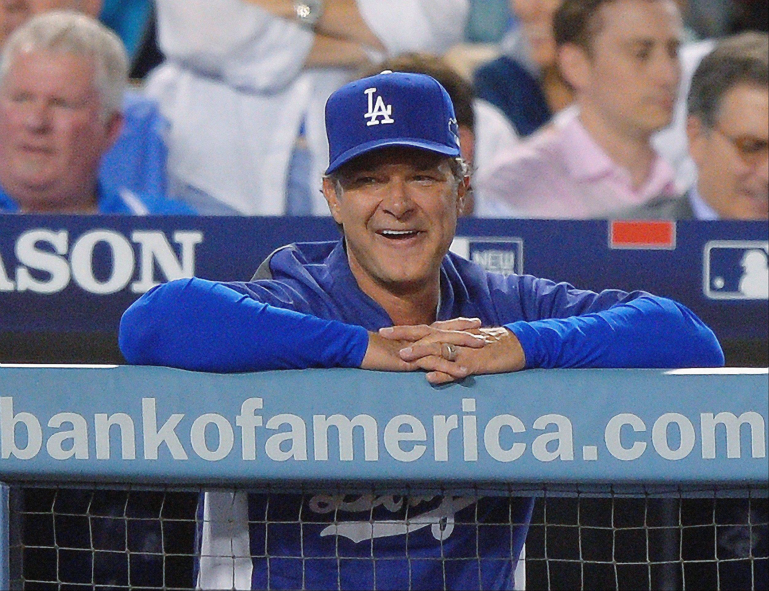 Dodgers manager Don Mattingly smiles during a pitching change in the eighth inning of Game 3.