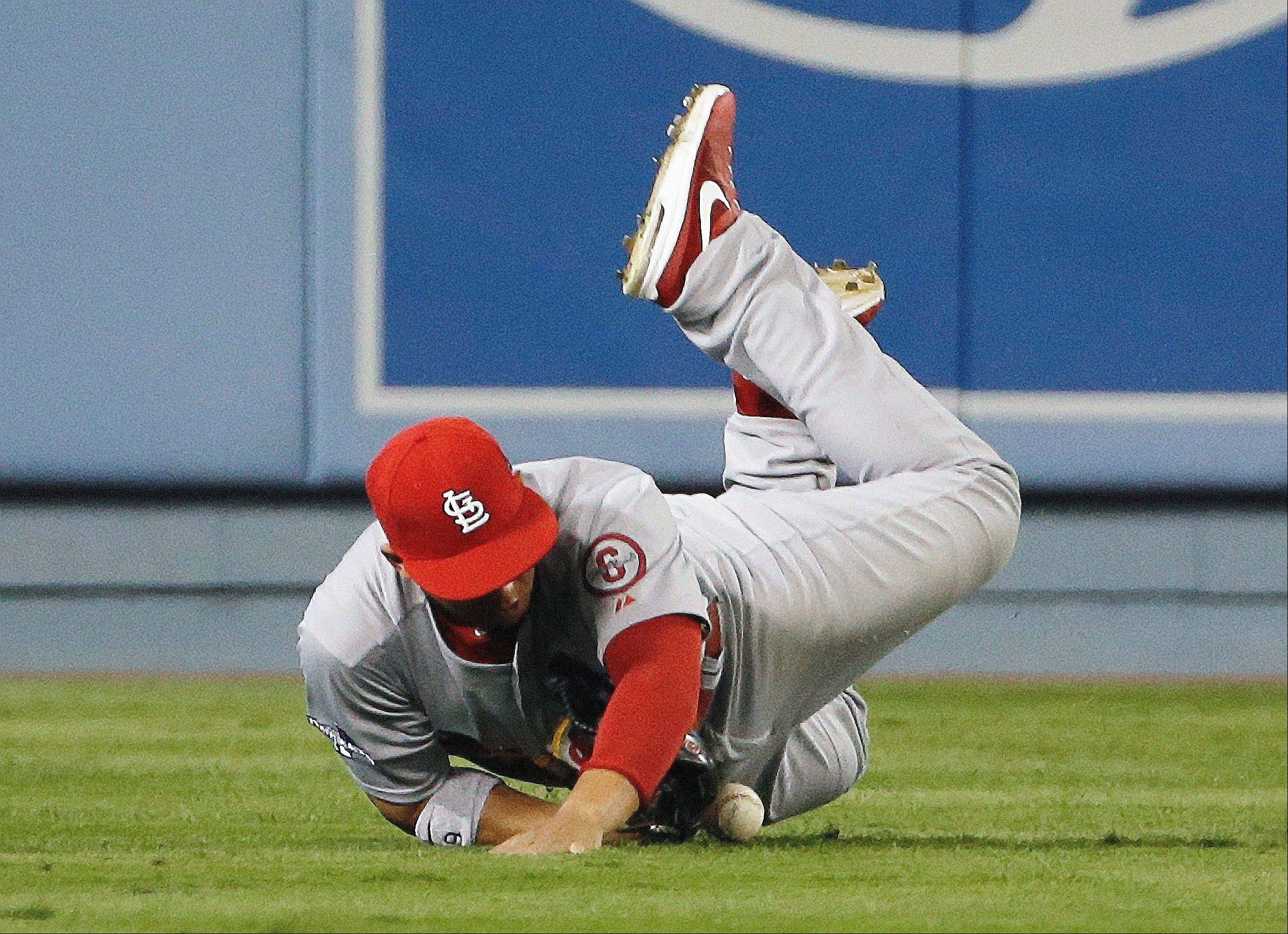 The Cardinals' Jon Jay can't catch a ball hit by the Dodgers' Carl Crawford during the eighth inning.