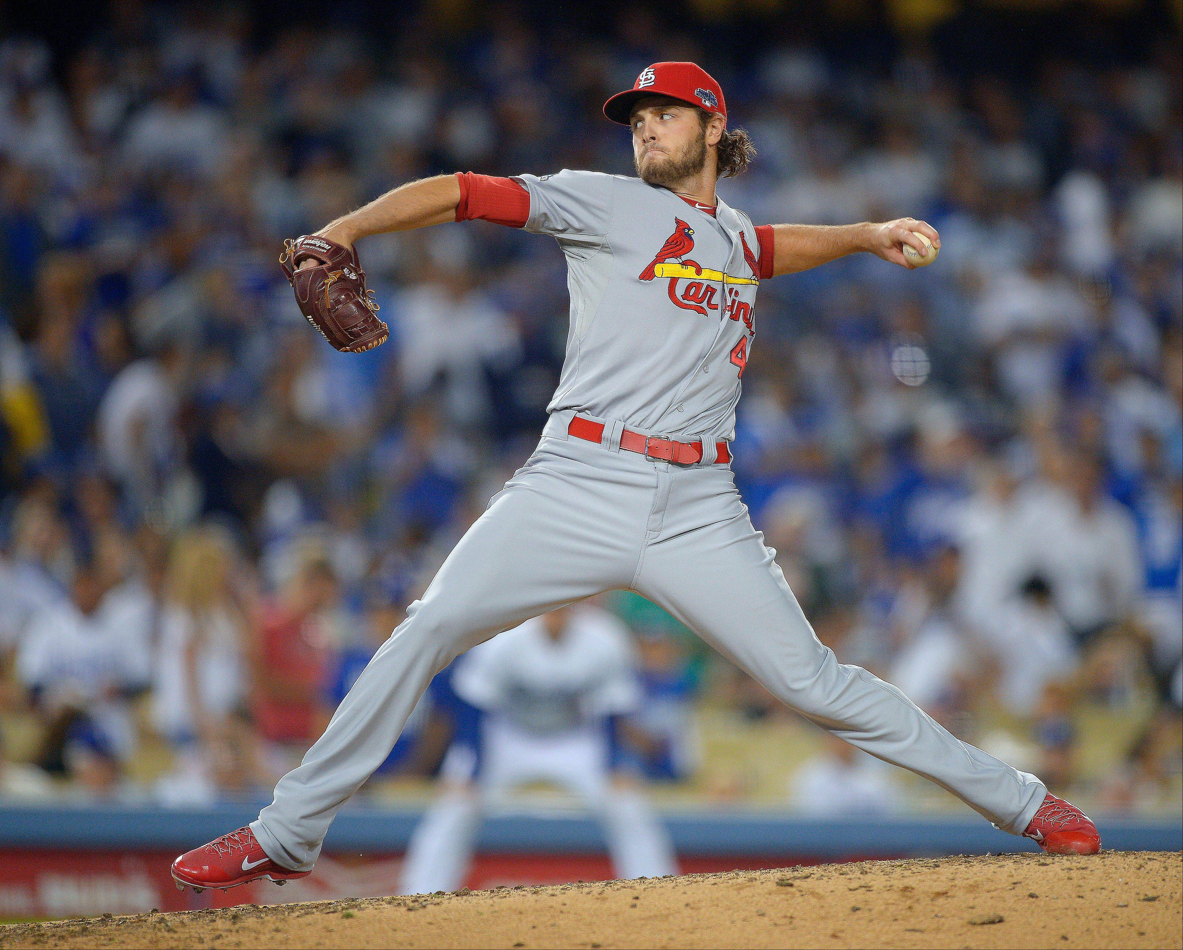Cardinals relief pitcher Kevin Siegrist throws during the eighth inning of Game 3.