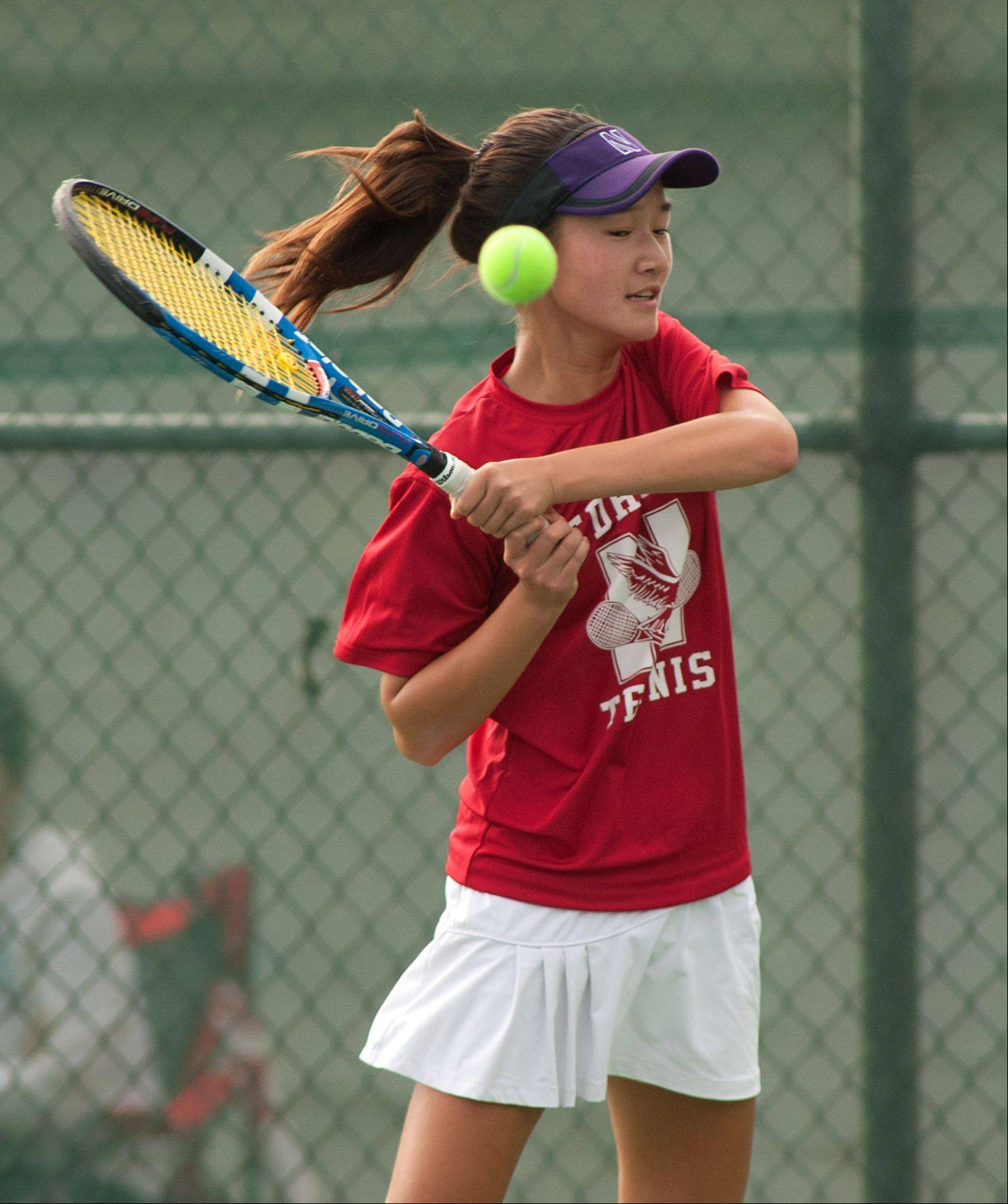 Naperville Central's Tiffany Chen returns a volley during the DuPage Valley girls tennis finals at Naperville Central.